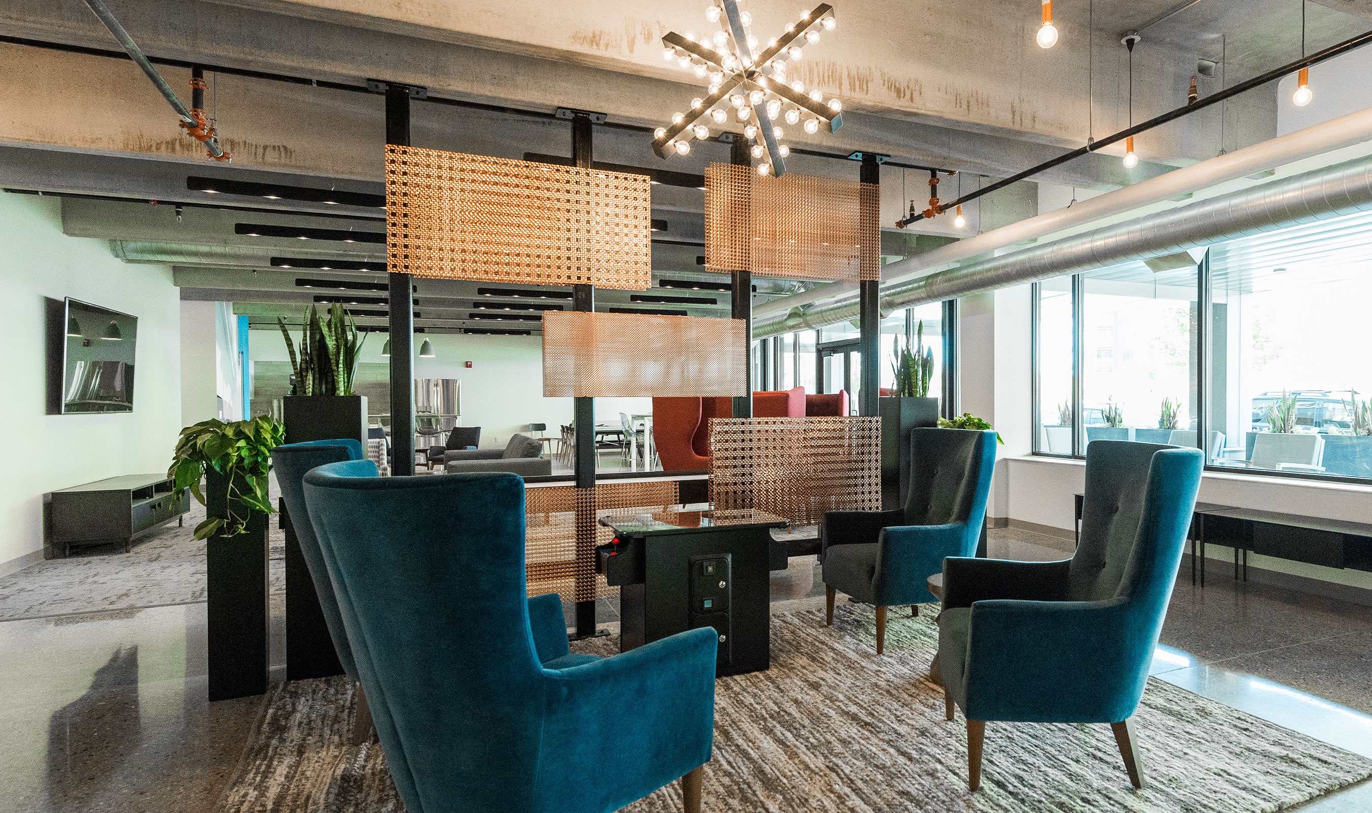 Brothers Interiors selected Banker Wire decorative mesh to use as an artistic interior space divider