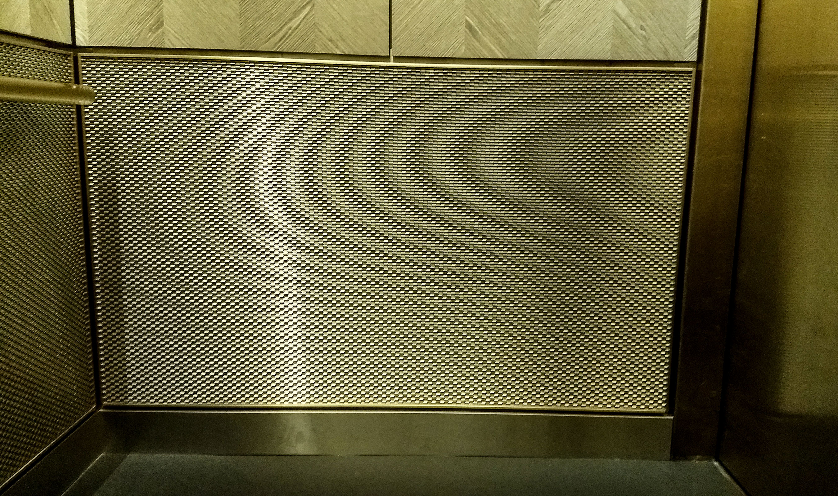 Decorative wire mesh is a beautiful solution to high traffic areas, such as elevator cabs.