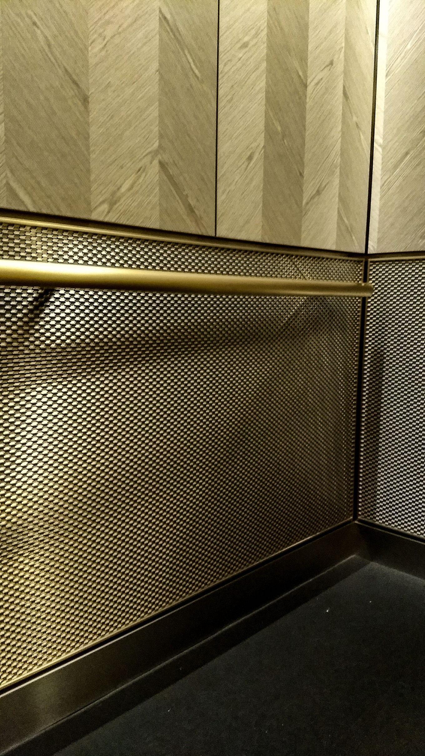 DS-1 is a beautiful contrast to the grey herringbone patterned wood veneer used on the upper wall panels of the elevator.