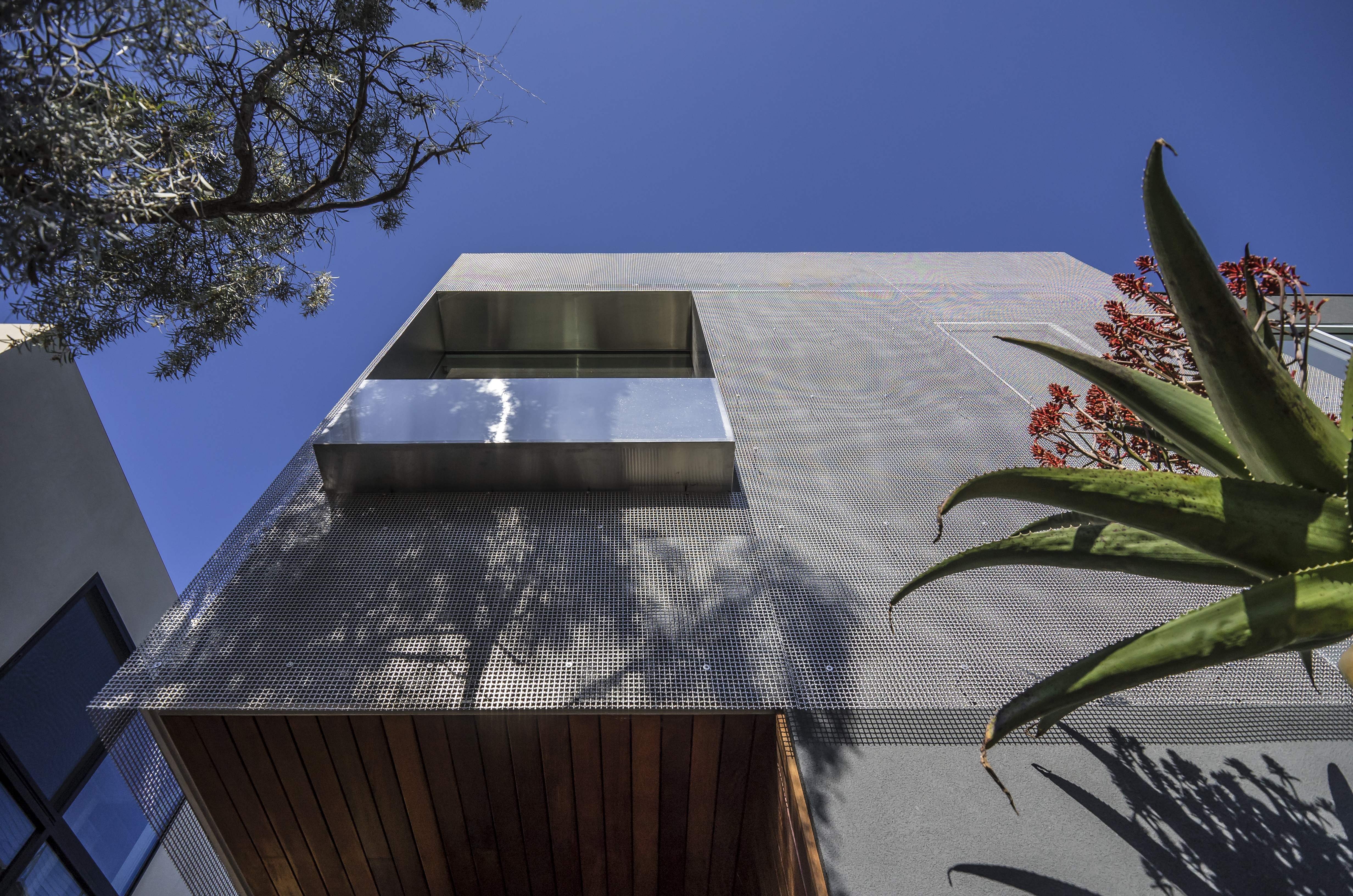 The S-9 wire mesh screen provides significant shading for the Southwest facade.