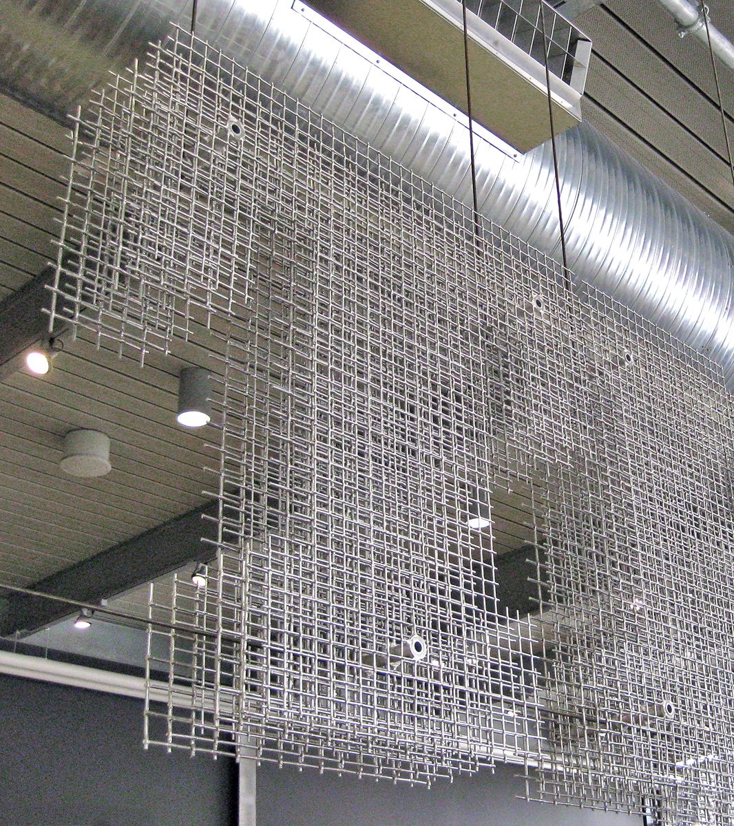 A variety of Banker Wire mesh patterns create this layered, sculptured sign.