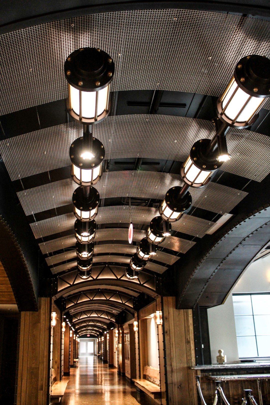 The mid-fill weave of S-9 in T304 stainless steel proved to be the perfect choice for the hallway ceiling panels.