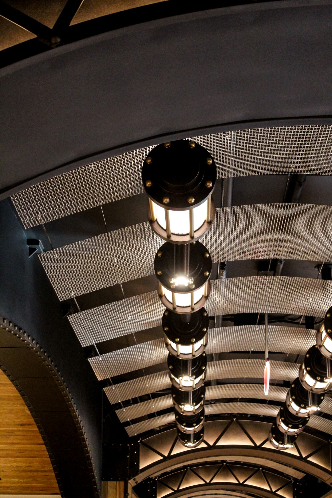 The luster of Banker Wire architectural mesh plays of the light fixtures.