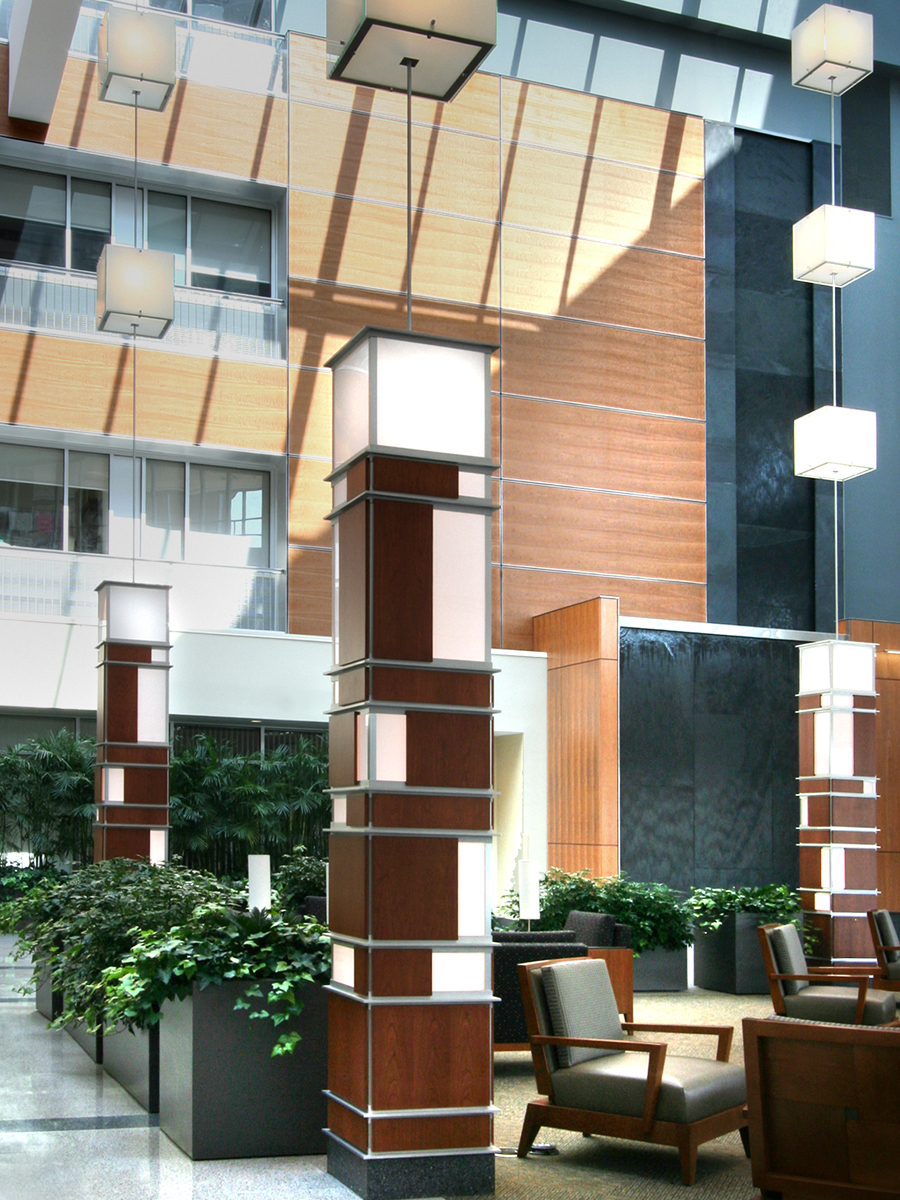 The wire mesh brings texture to the hospital space, adding depth to its walls.