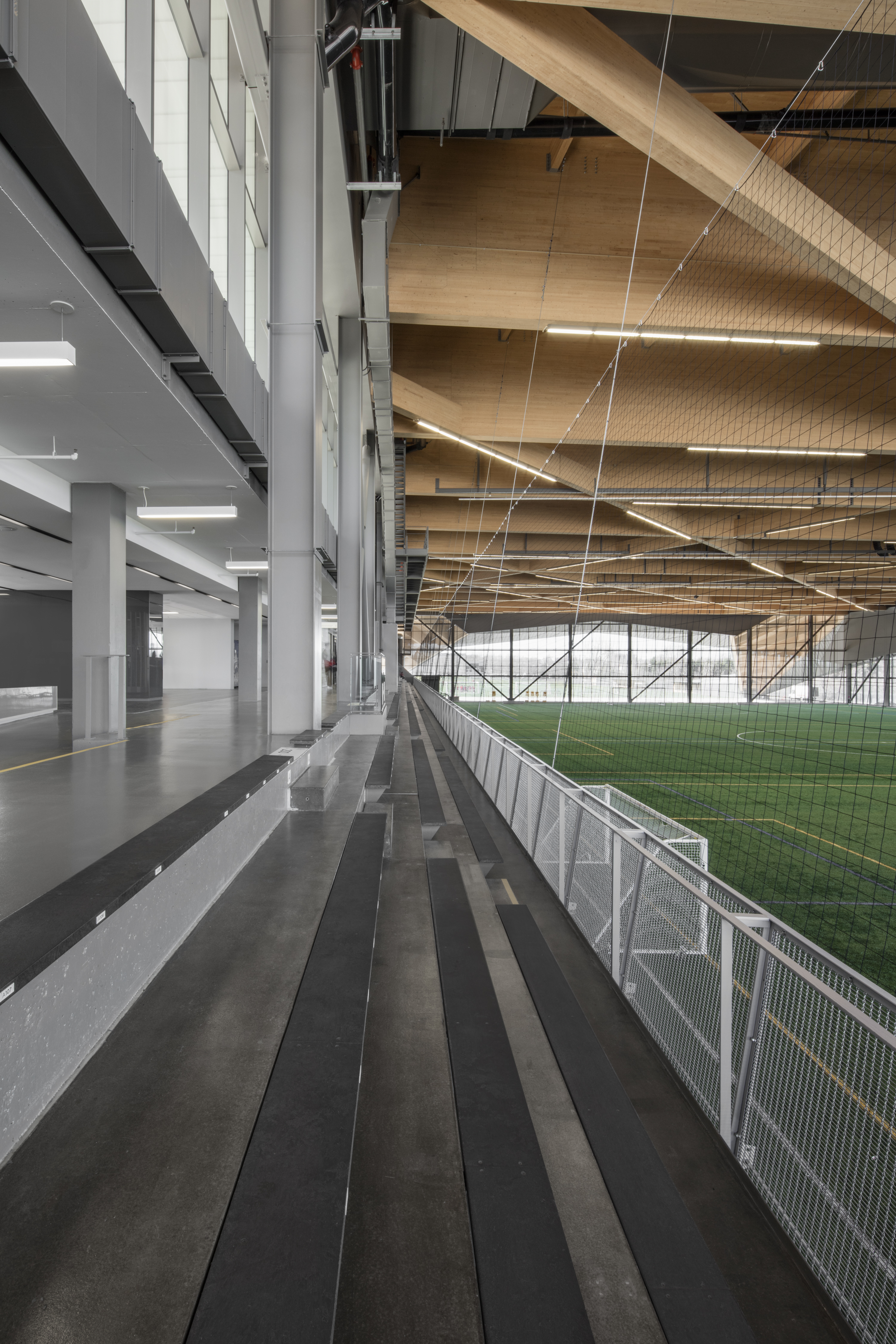 The railing and enclosure spans two stories in the soccer stadium, using M12Z-17 woven wire mesh.