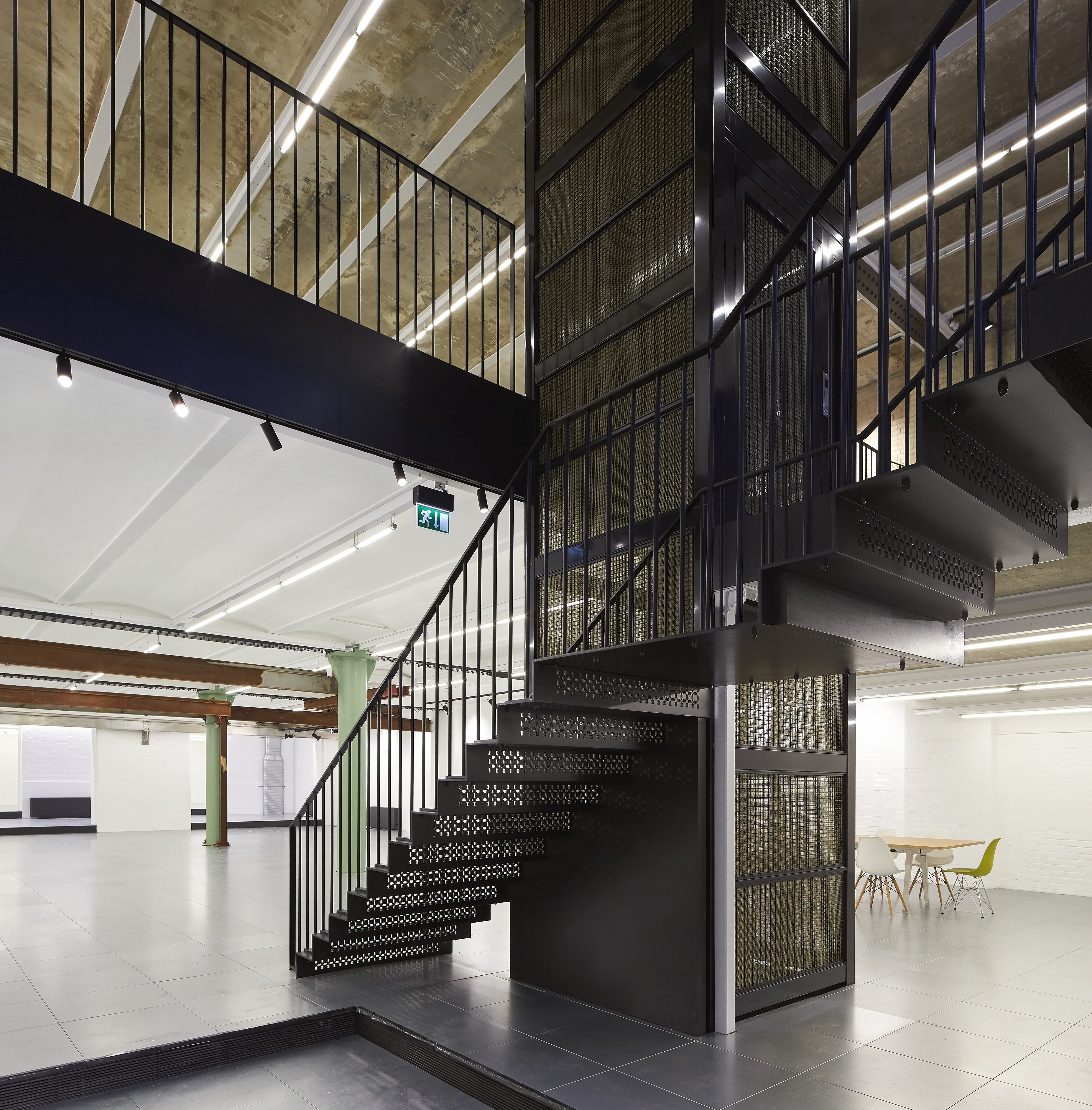 The lift and the surrounding elements of the building create a very industrial look to the space.