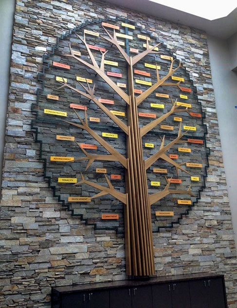"""Banker Wire mesh forms the """"Tree of Success"""" sculpture at Fox Valley Technical College. The woven wire mesh is a perfect canvas on which to hang the Tree of Success' """"leaves."""""""