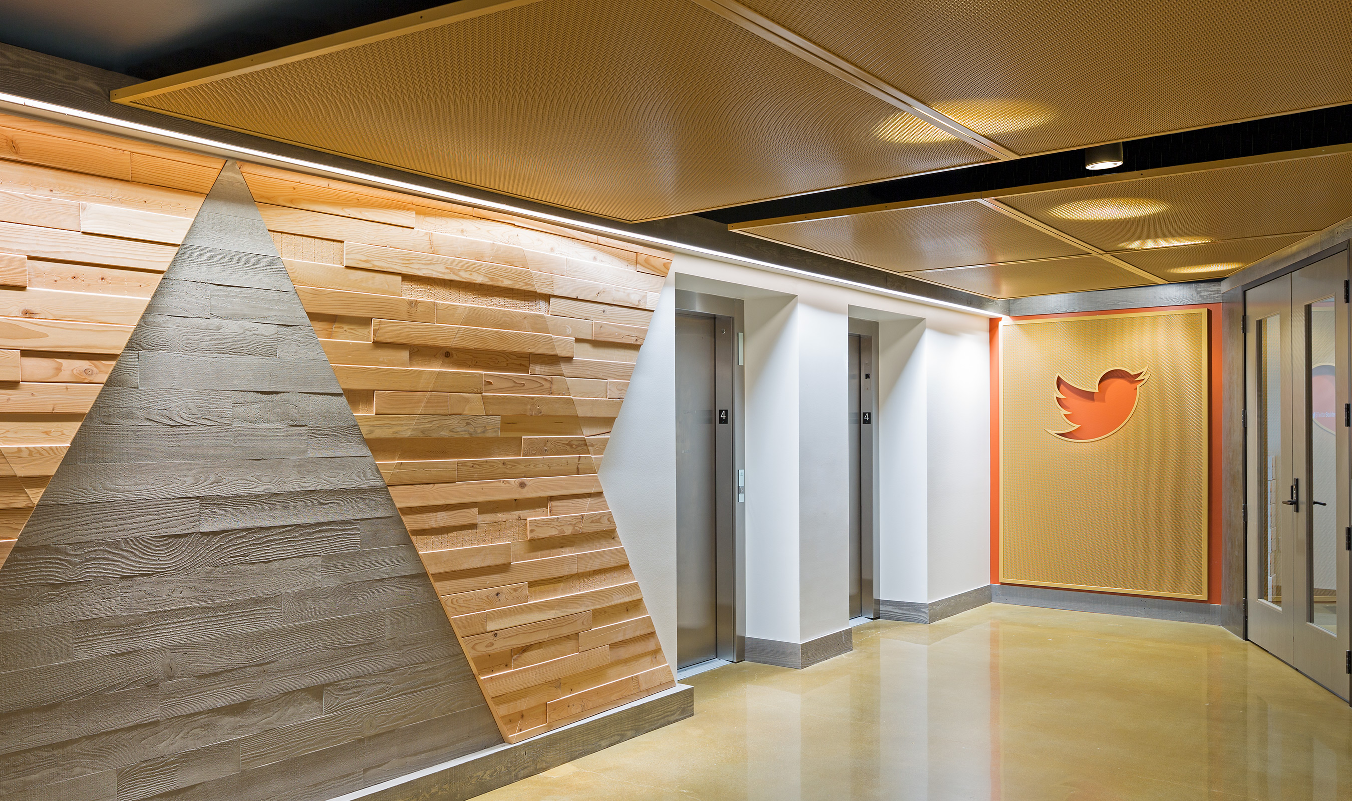 The TW-1 wall cladding located near the elevators features a laser-cutout of the iconic Twitter logo.