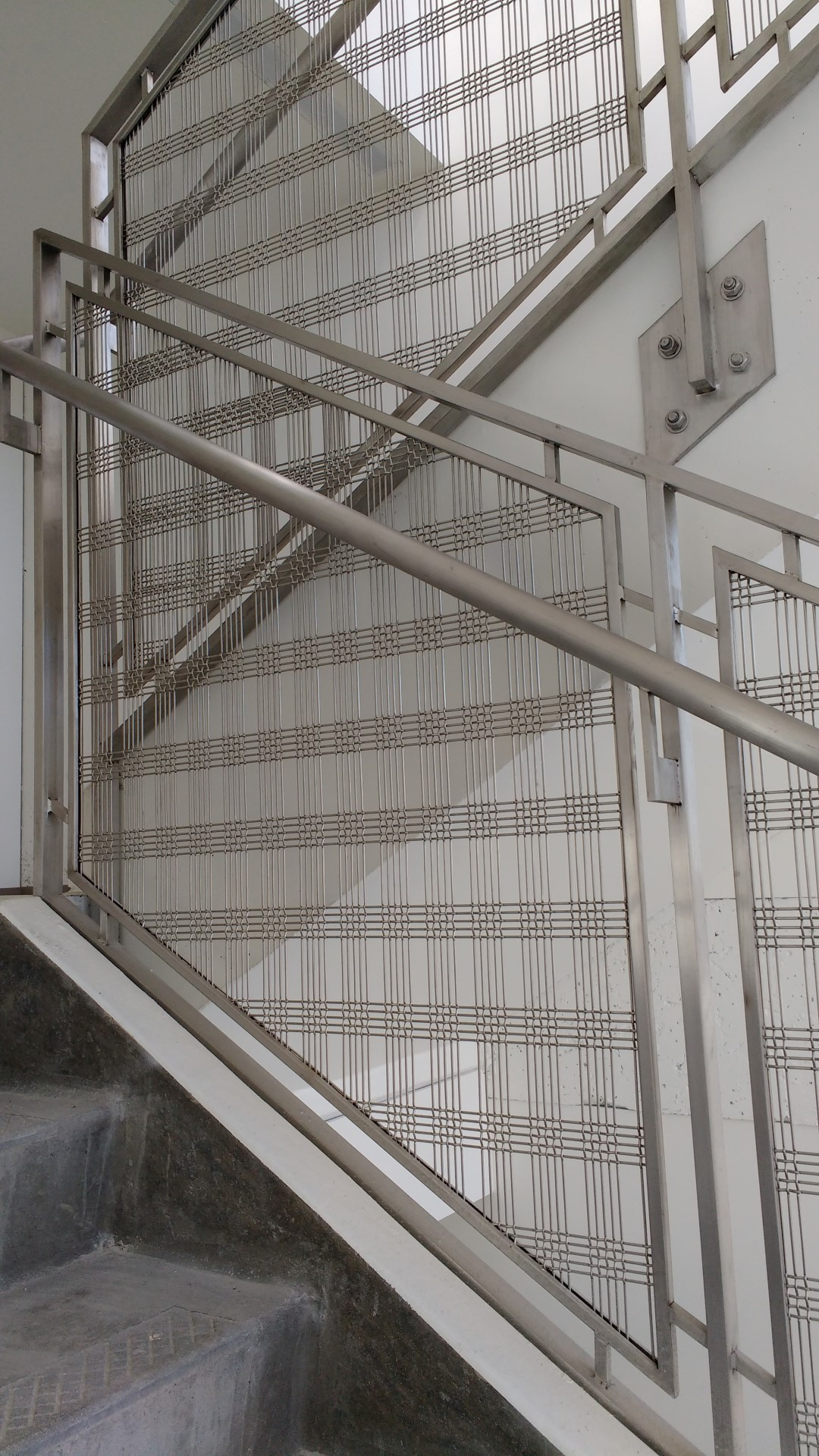 Banker Wire infill finishes off a stairway that mirrors the sophistication of the research performed at this facility.