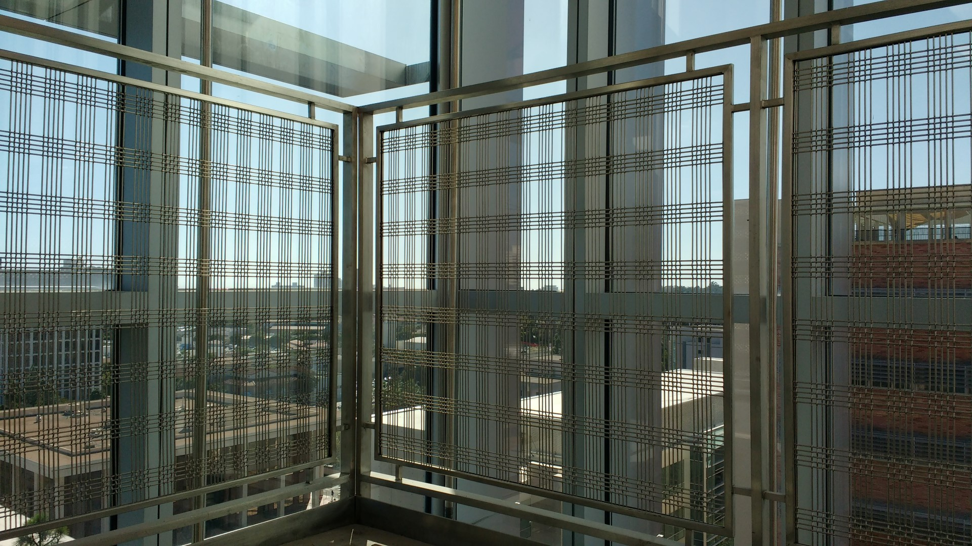 Banker Wire mesh allows for the transmission of natural light in this glass enclosed stair tower.