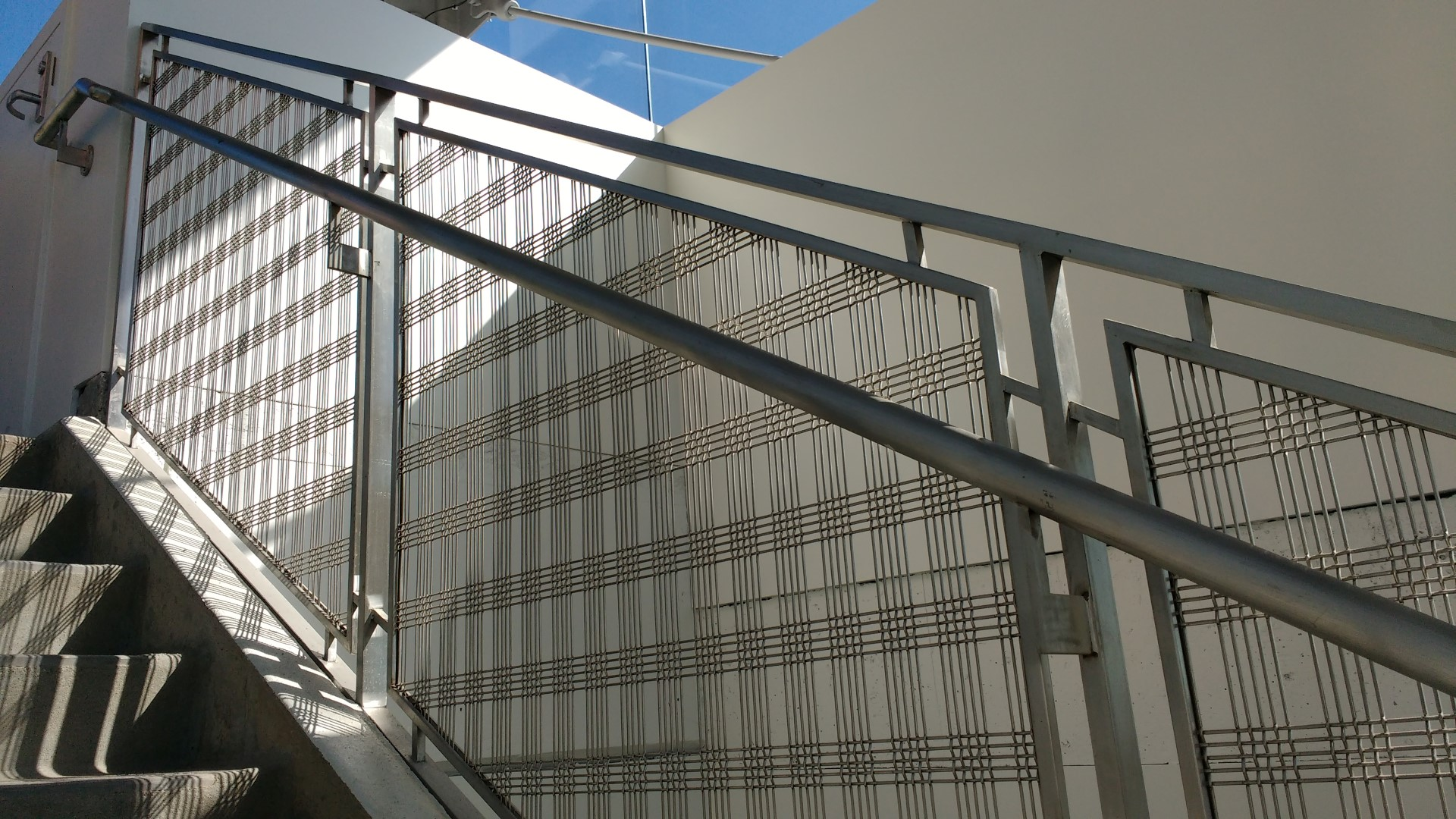 Well lit by the aboundance of southern California sunlight, the stair tower used a custom wire mesh pattern as railing infill material.