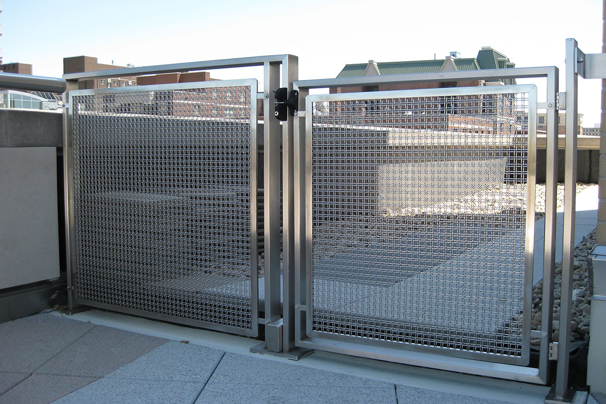 The twin wire flat top crimp style of the Banker Wire M22-22 architectural wire mesh makes an attractive railing infill panel.