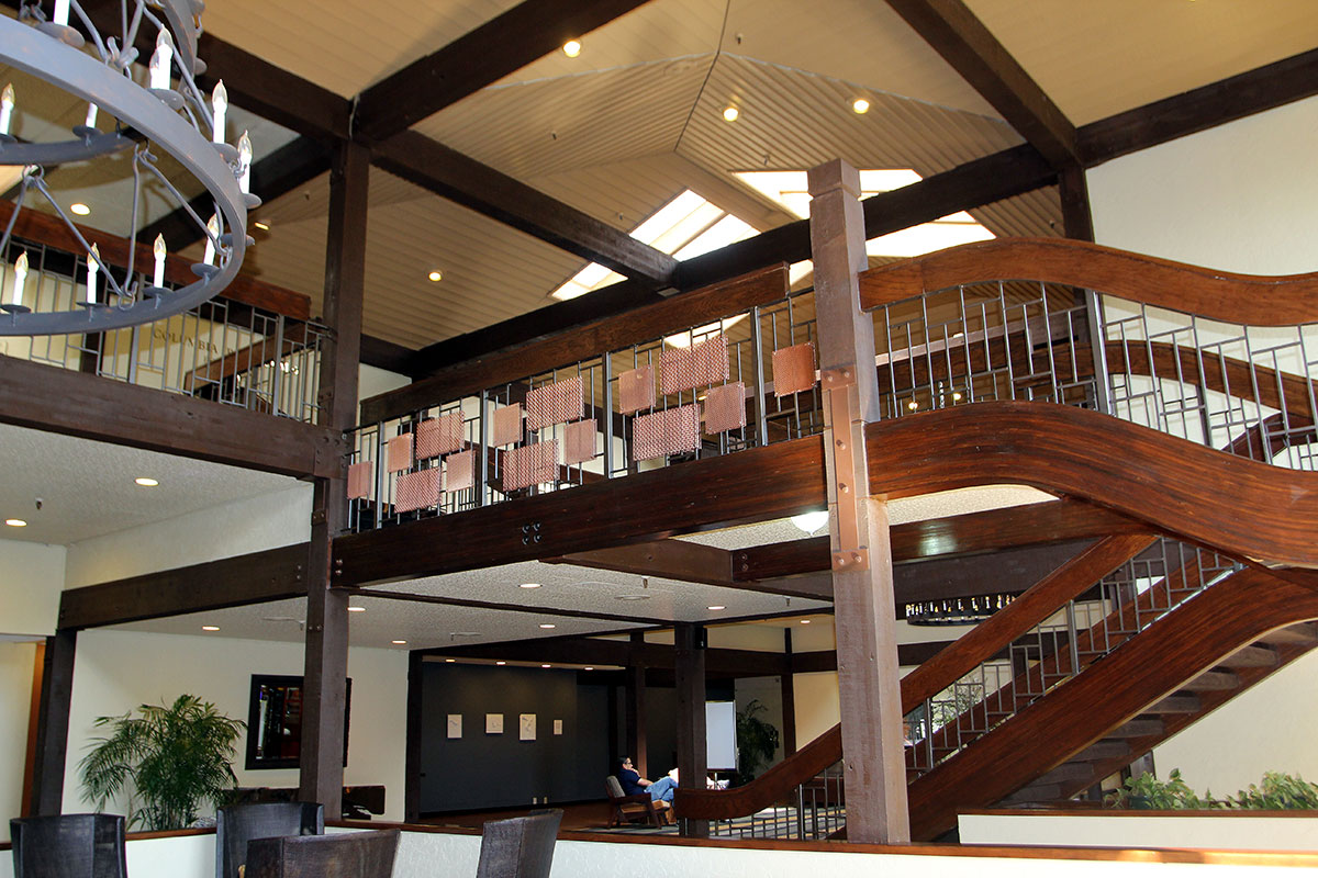 """Metal mesh accents """"dress up"""" this interior railing."""