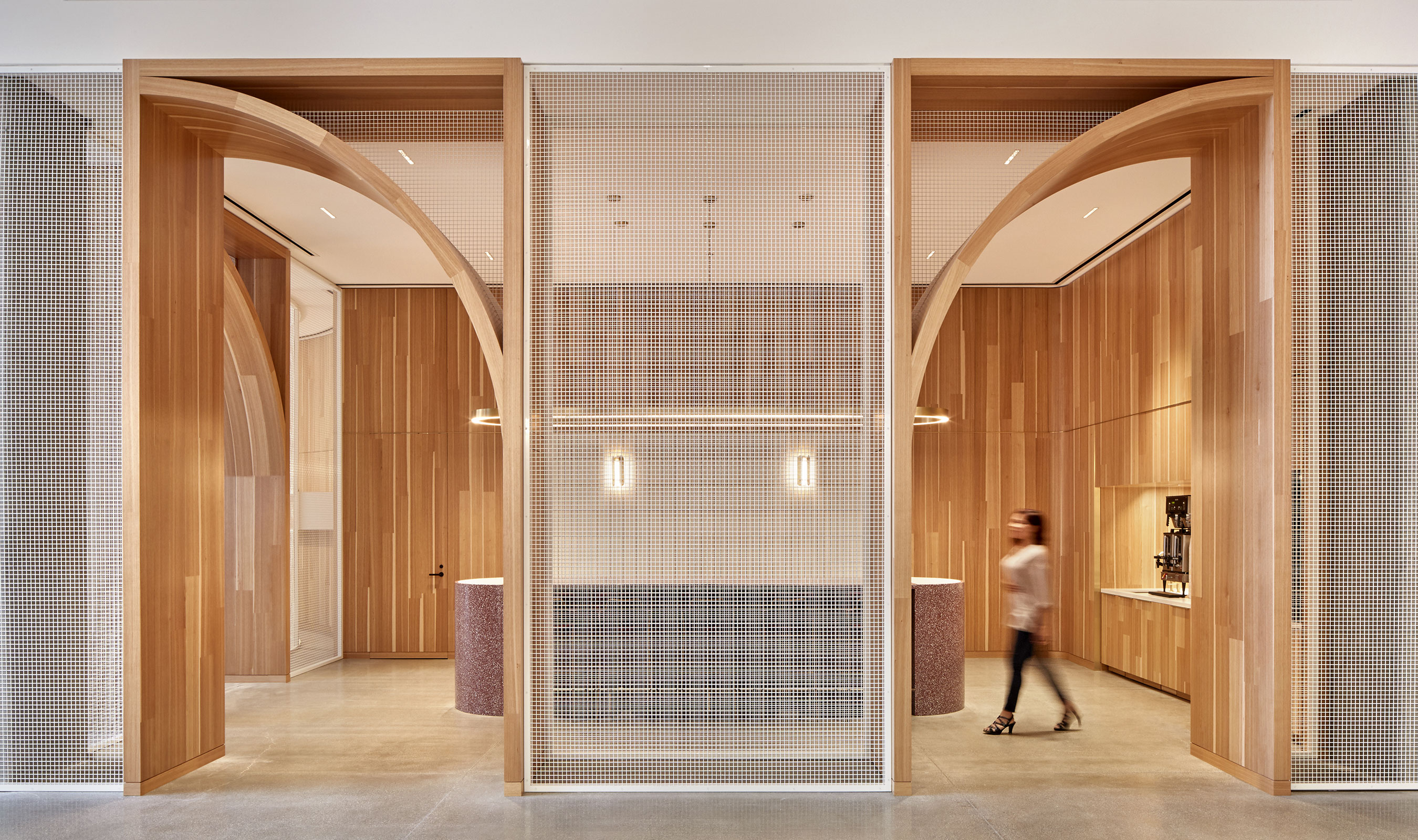 The simple but rigid form of L-81 by Banker Wire juxtaposed against the natural wood helps to give this corporate space an open and airy aesthetic