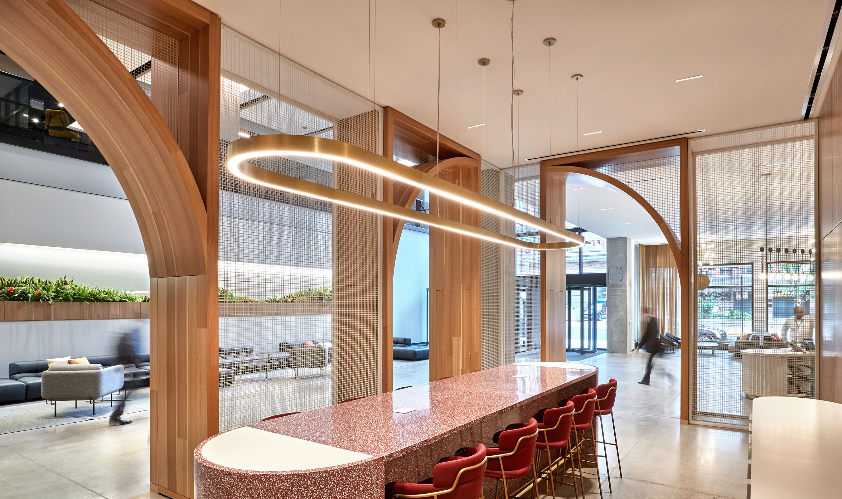 The large percent open area of wire mesh pattern L-81 gives the illusion of separated spaces while maintaining sight lines in this lobby space.