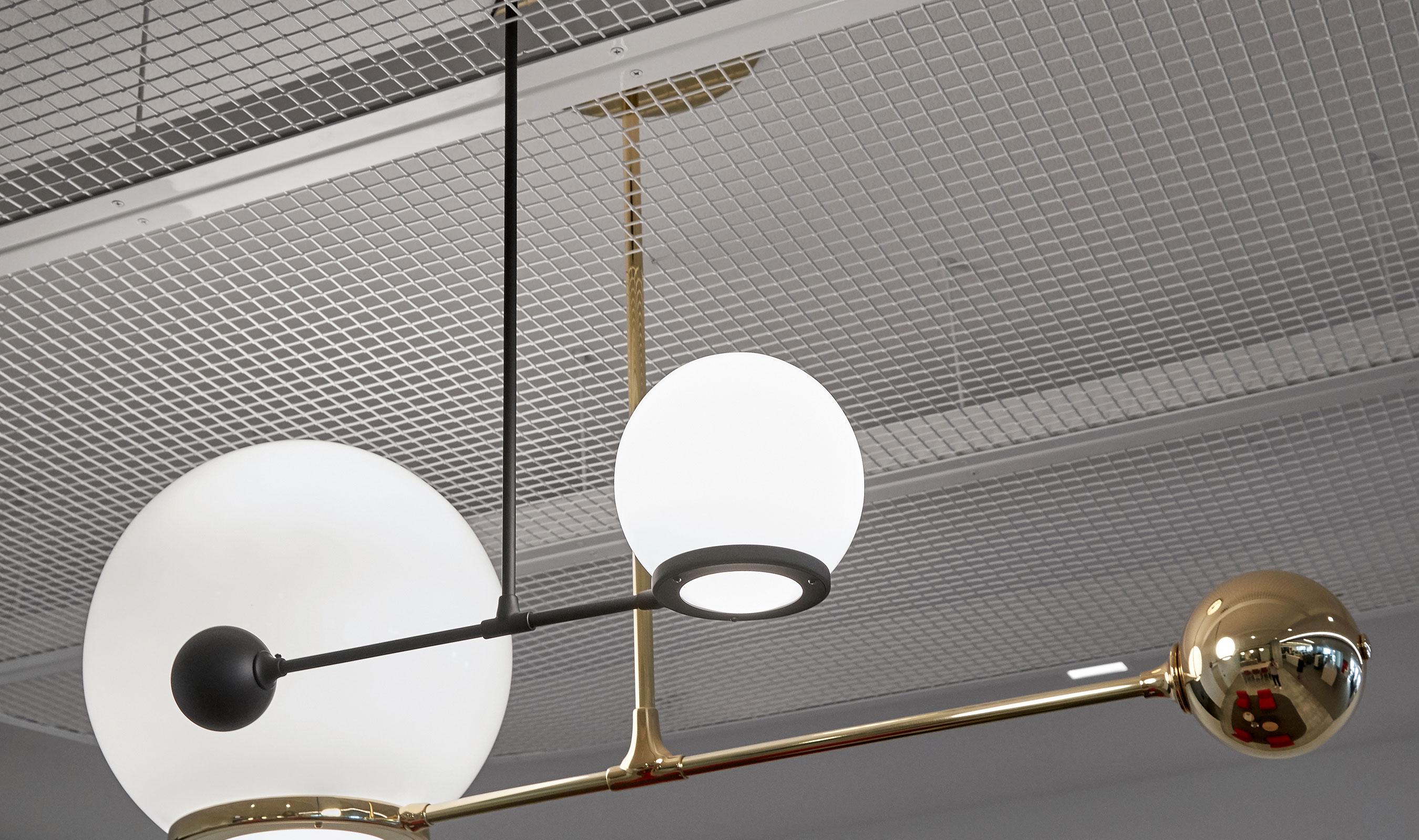 Decorative ceiling elements using L-81 provide textural interest against metallic pendant lights.