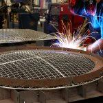 Custom wire mesh weld fixture for snow machine guards