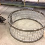 Rolling the mesh and welding to flat bar