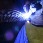 Weld torch creating safe edge on woven wire mesh