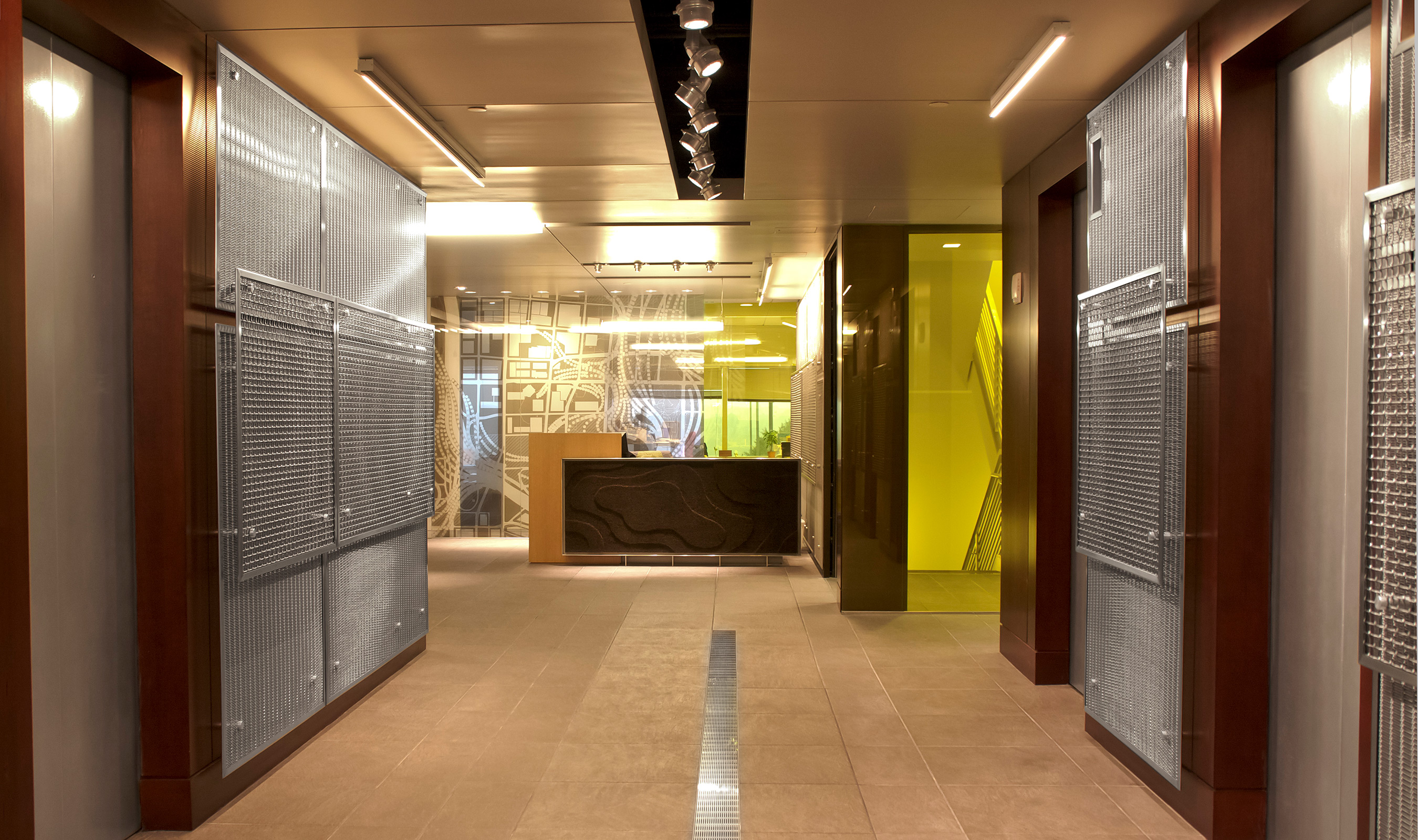 The layered decorative mesh creates a stunning visual to this elevator lobby in the AECOM offices.