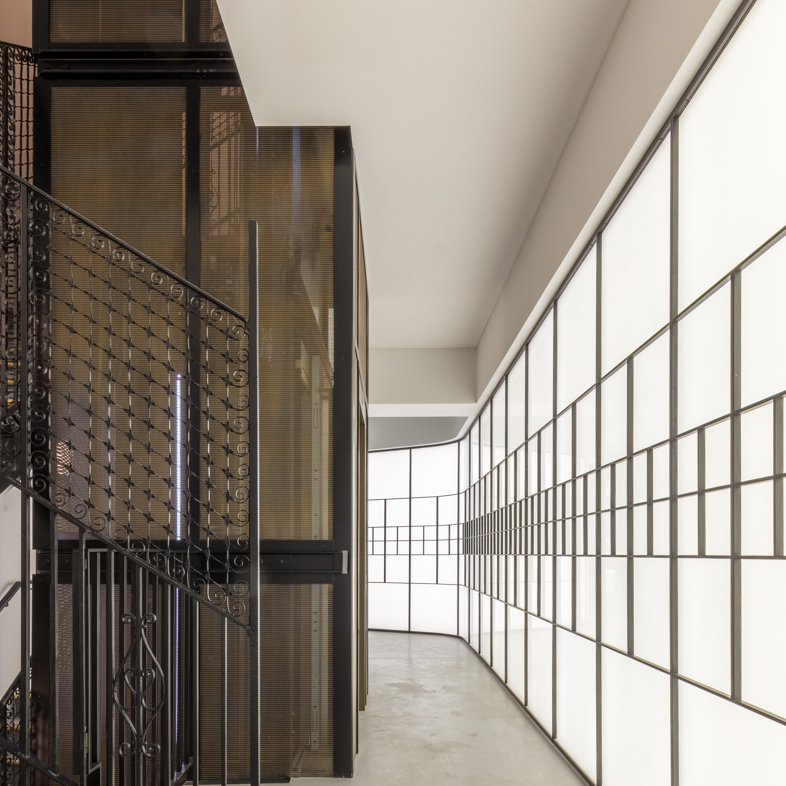 """The fine woven wire mesh adds a contemporary yet classic element that """"meshes"""" well with the historical nature of the Minerva Building."""
