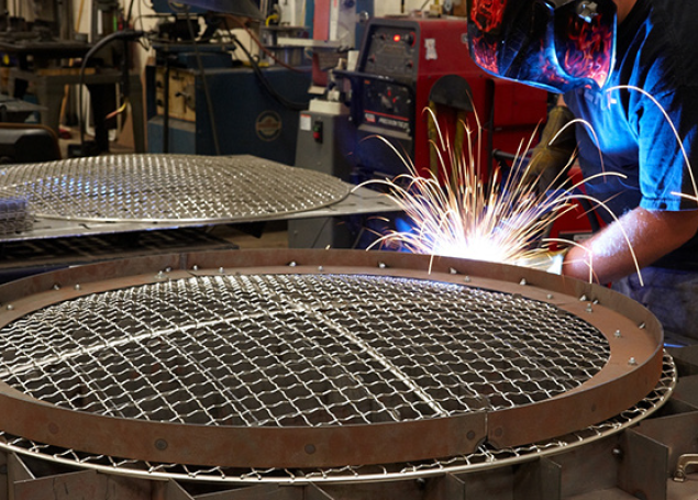 our wire mesh being welded by an employee