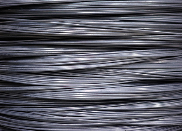 a close up of spool of wire mesh