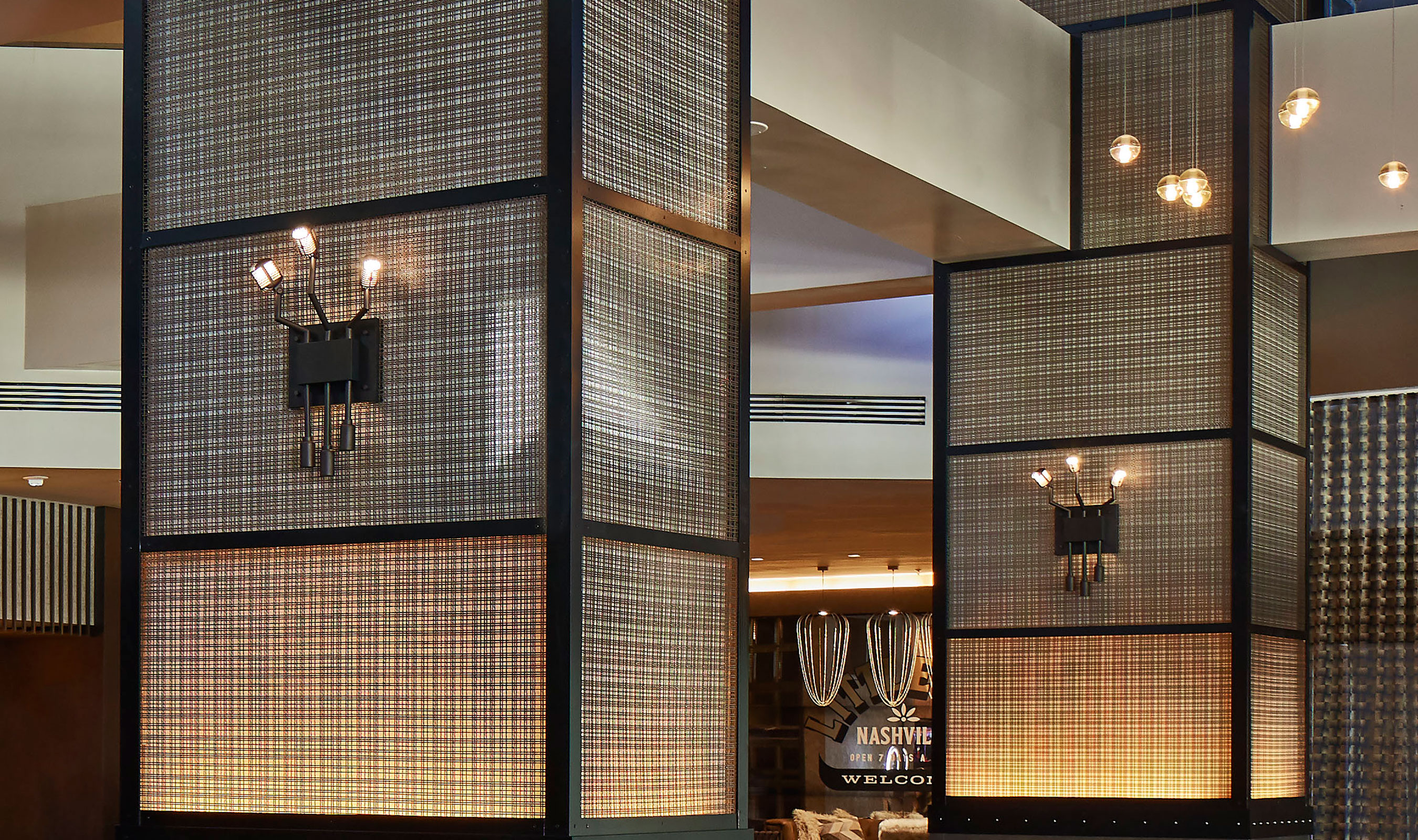 Banker Wire's SJD-21 creates interesting patterns as it is backlit on columns in the lobby.