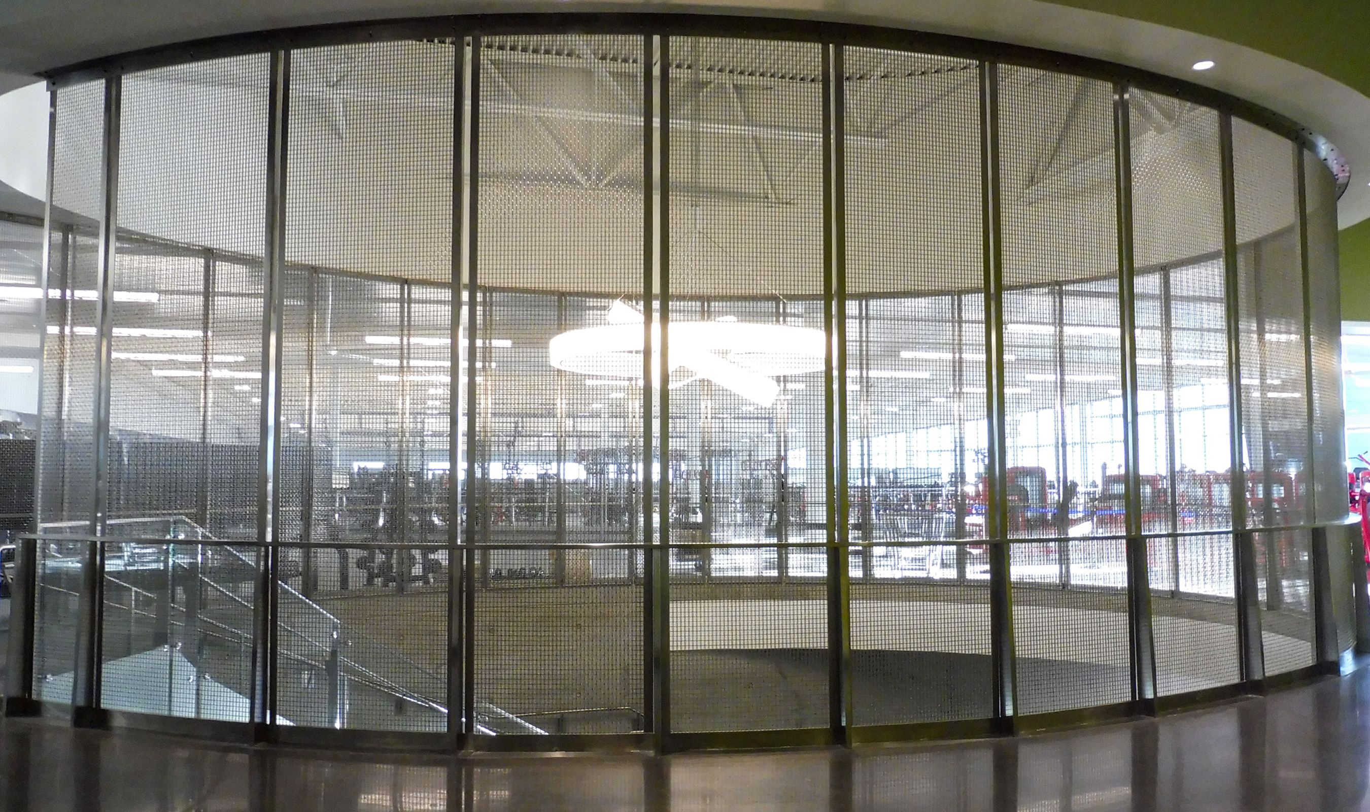 The 60% open area of Banker Wire's SJD-7 woven wire mesh allows for uninterrupted sight lines while still giving a sense of separation in the building.