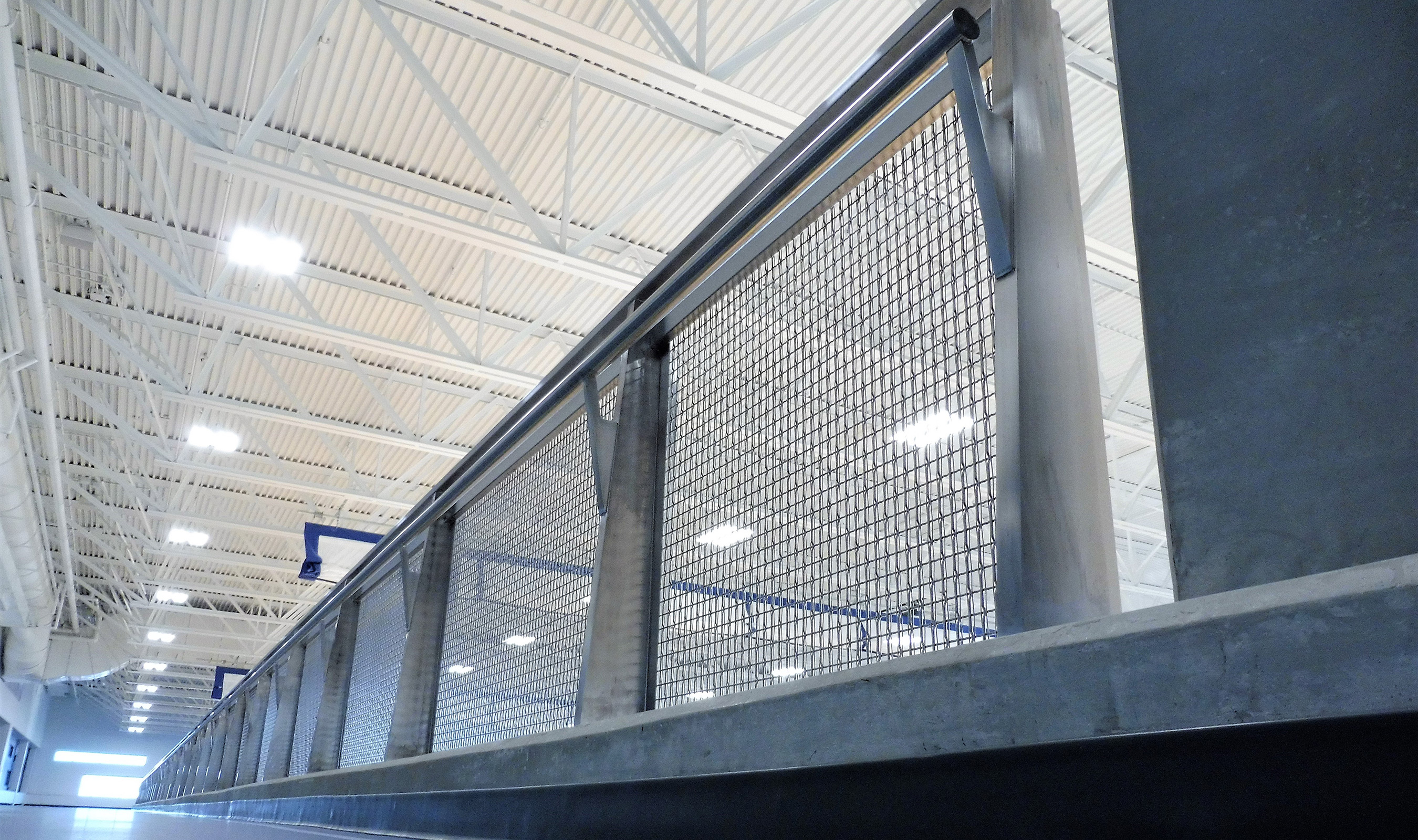 The light sparkles beautifully off of Banker Wire's SJD-7 woven wire mesh as railing infill.