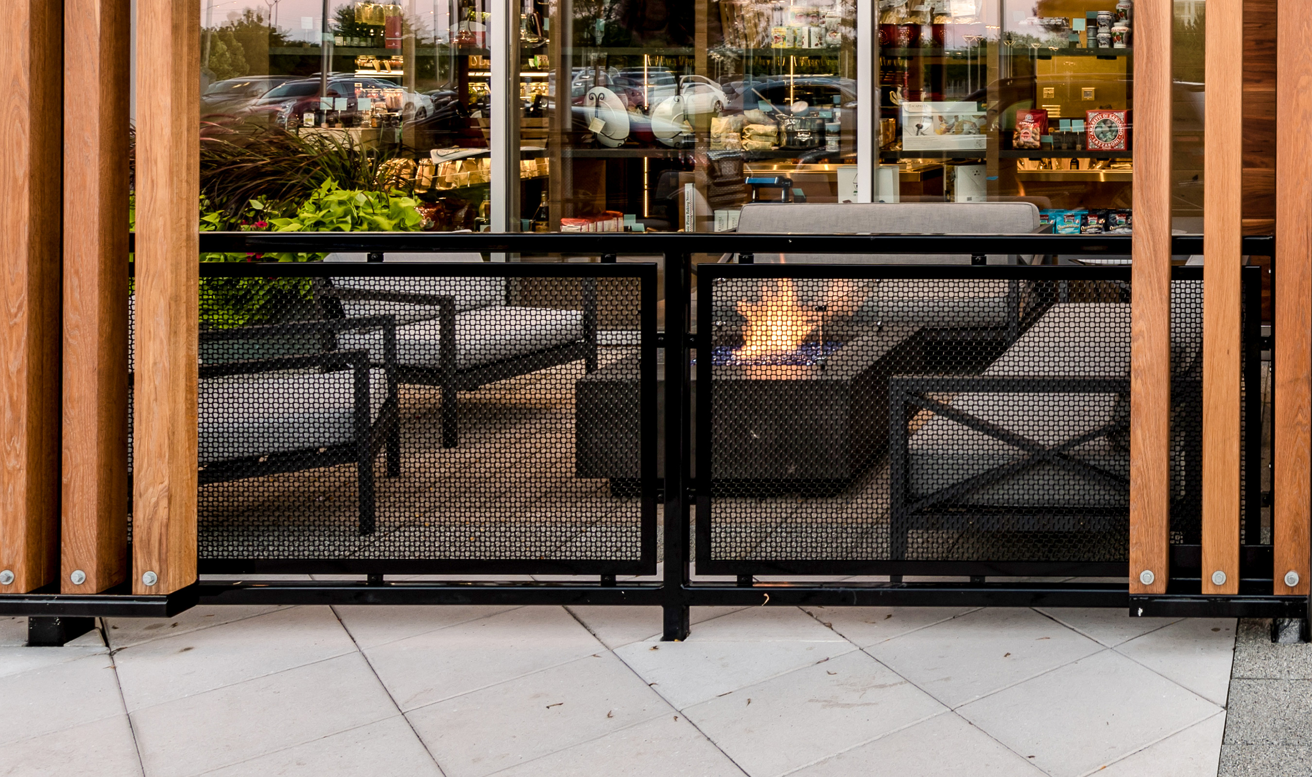 The secluded atmosphere of Che Figata's patio is thanks in part to Banker Wire's H-1 woven wire mesh pattern.