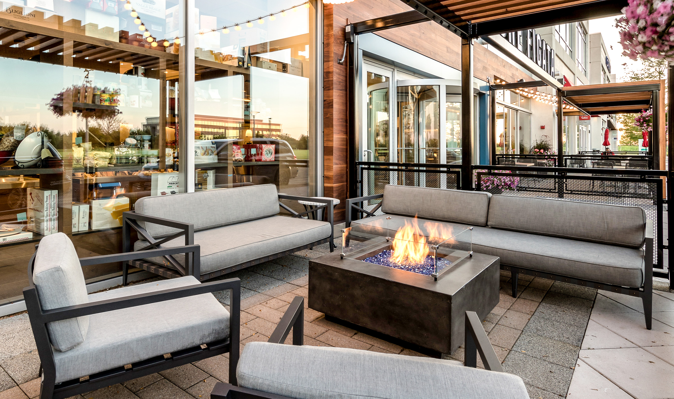 The luxurious patio at Che Figata is surrounded by railing that uses Banker Wire's H-1 architectural woven wire mesh pattern.