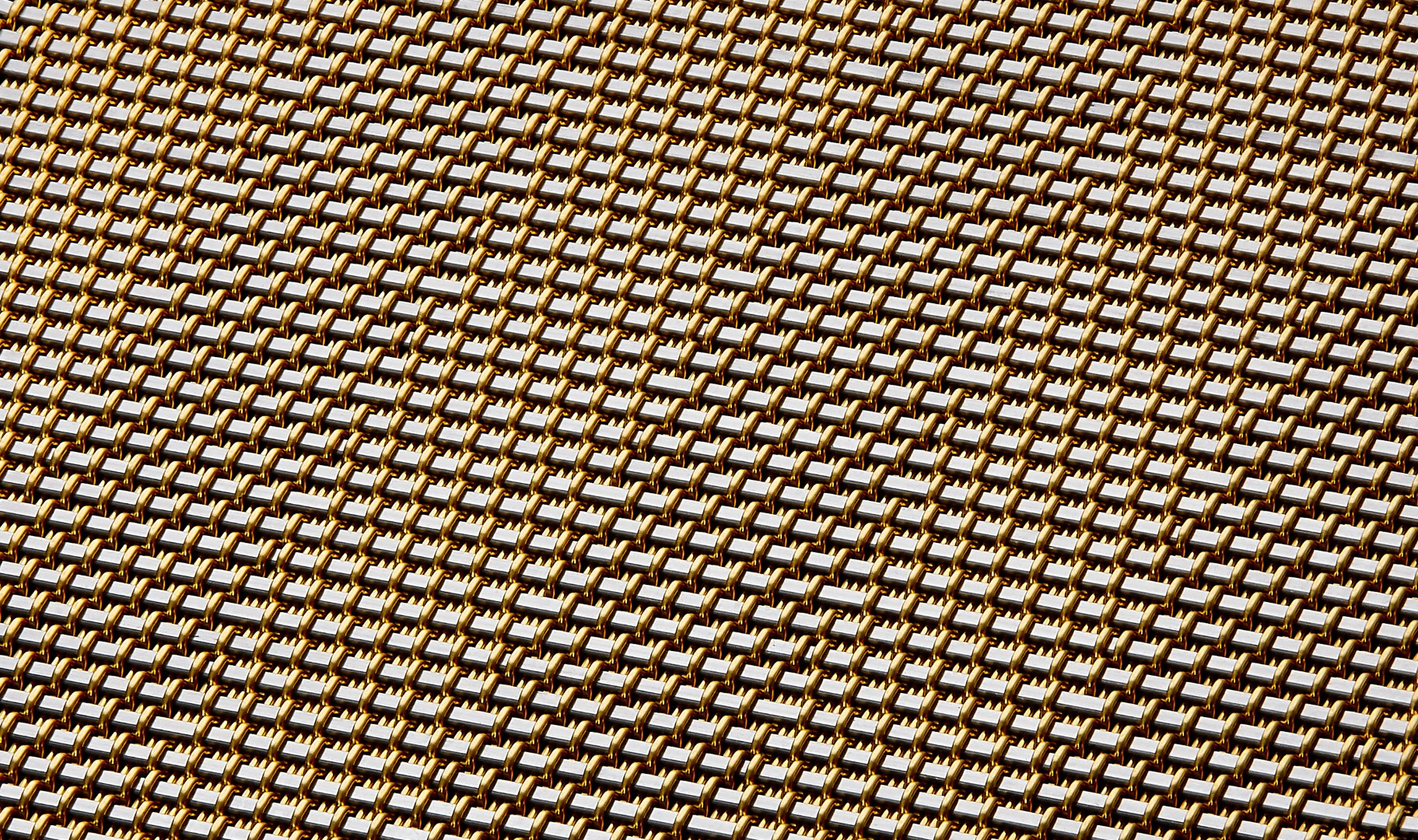 Backside of DT-1 Opaque architectural cladding mesh pattern woven in Stainless and Brass