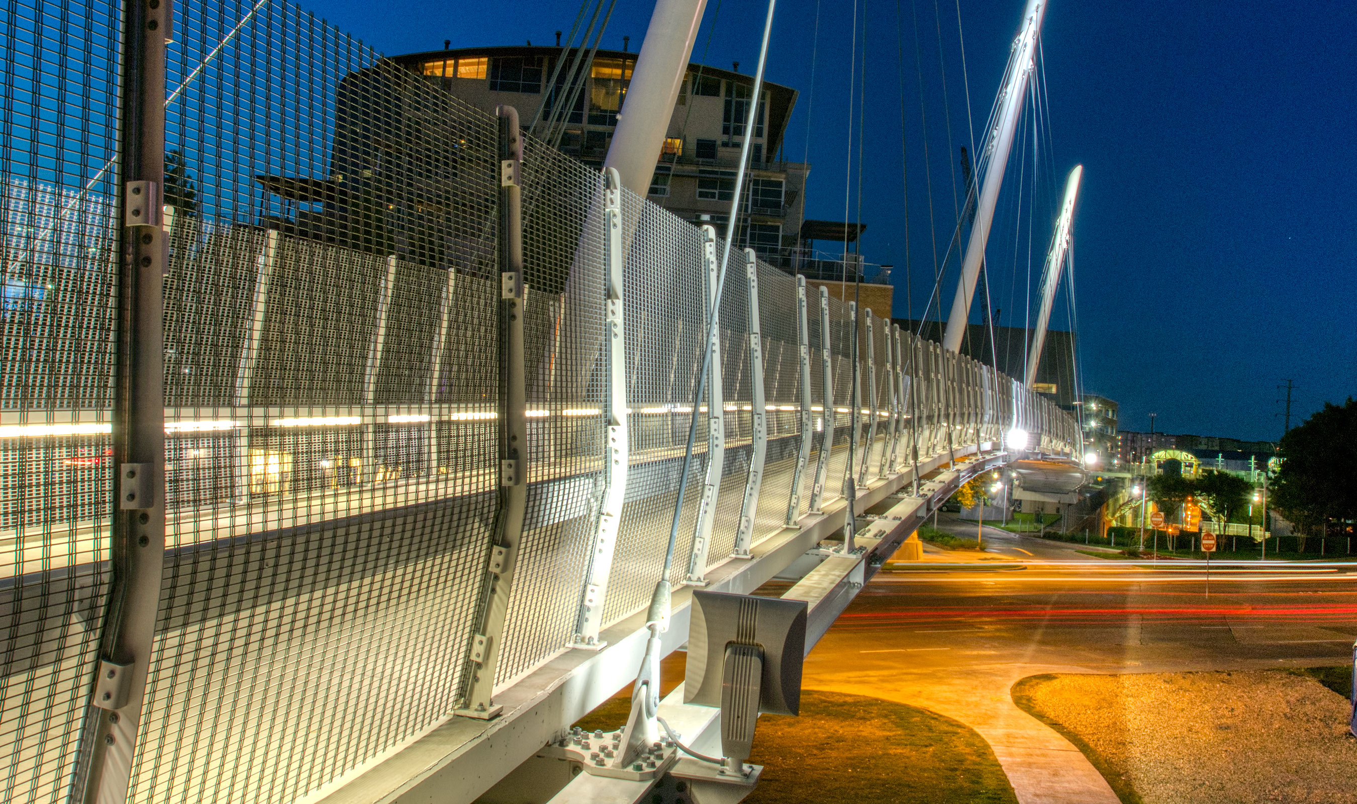 At night, lights shine on the Mockingbird Bridge, causing Banker Wire's M13Z-146 to blend in with the nighttime surrounds.