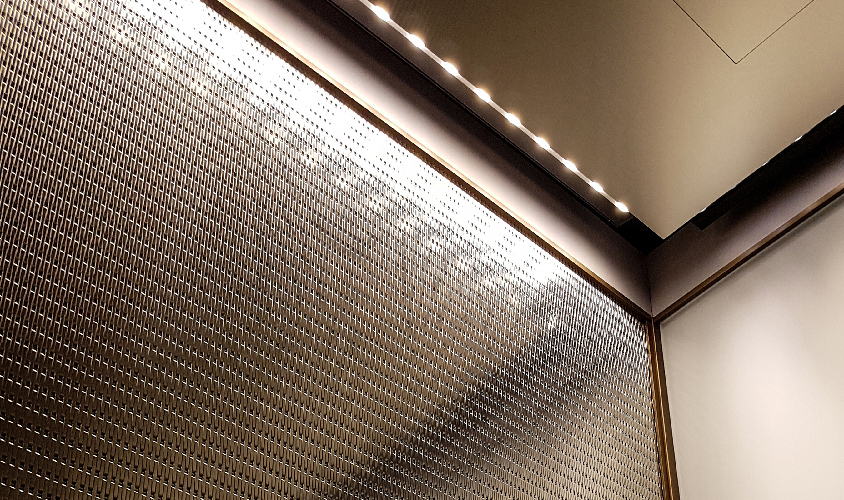 Light sparkles off of the flat surface of Banker Wire's DS-55 giving the elevator interior a soft glow.