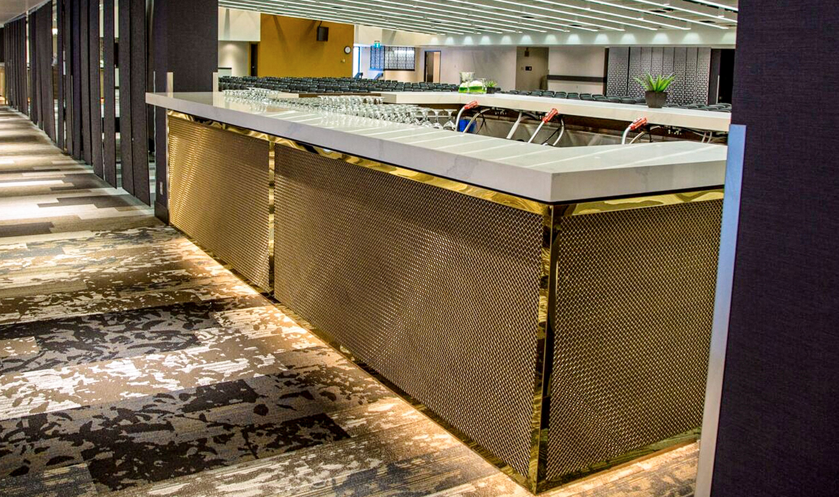Banker Wire's L-441 in bronze is used in a diamond orientation as bar cladding for the Red and White Club.