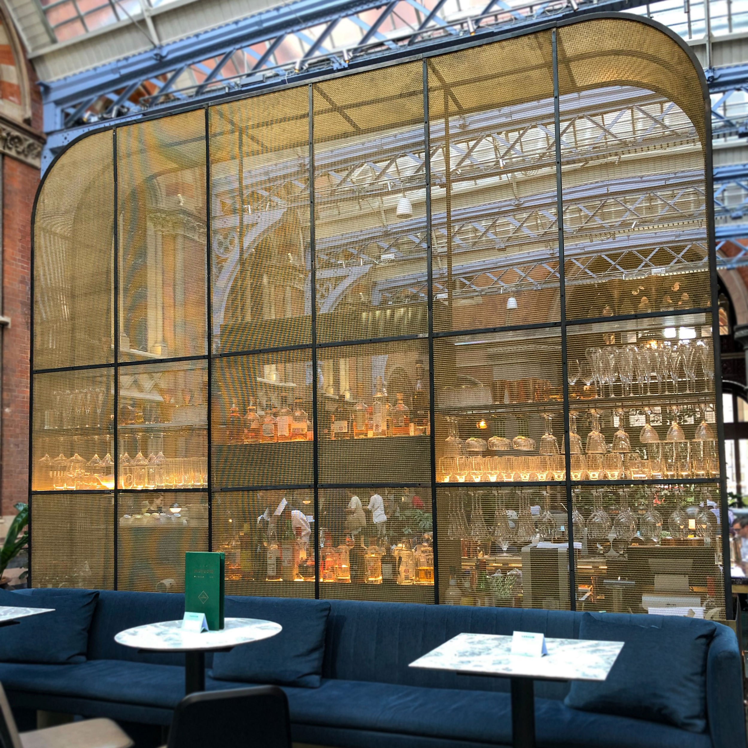 Banker Wire's LPZ-71 architectural wire mesh is used in brass as part of The Hansom's bar.