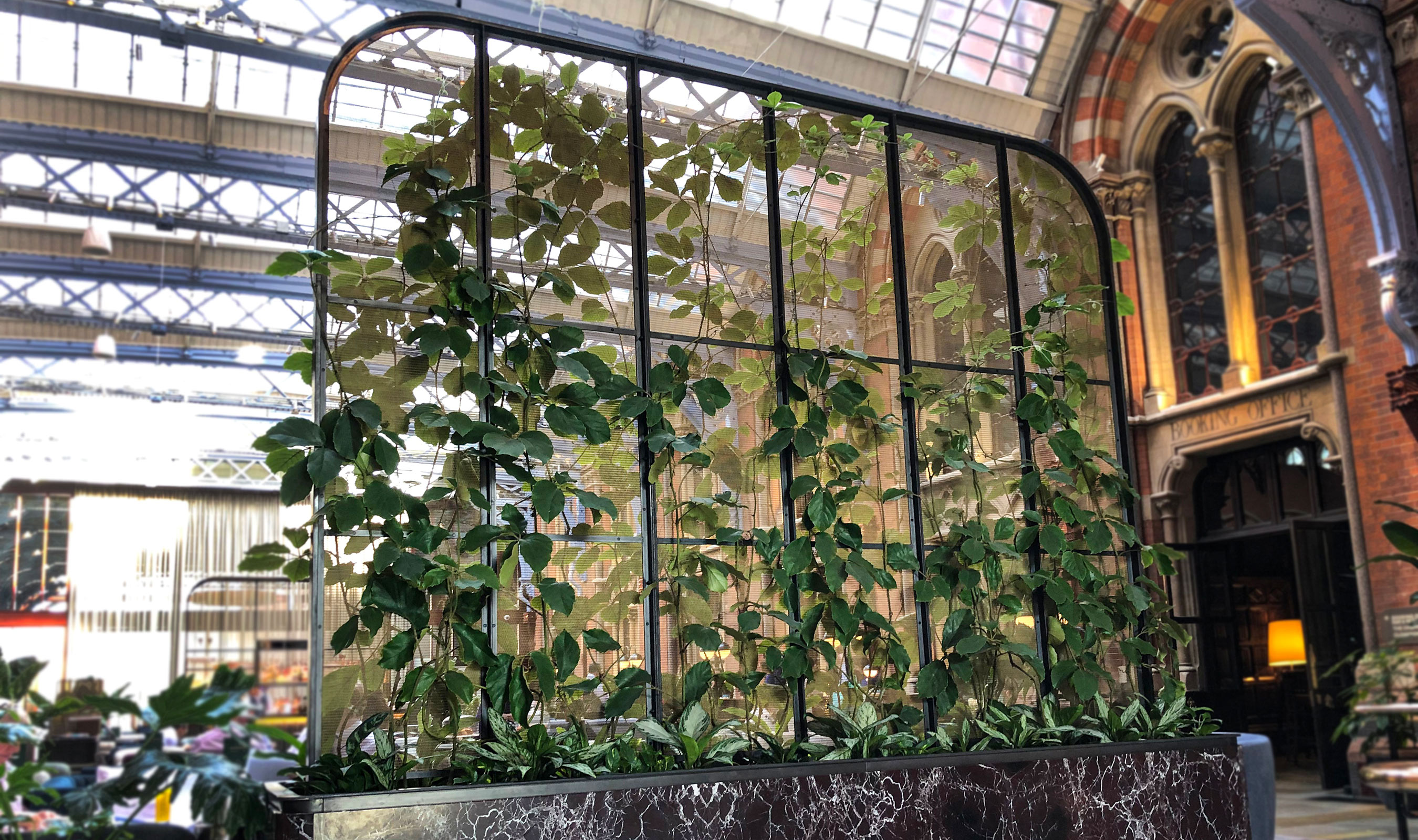 """A """"green wall"""" in The Hansom uses Banker Wire LPZ-71 woven wire mesh in brass"""