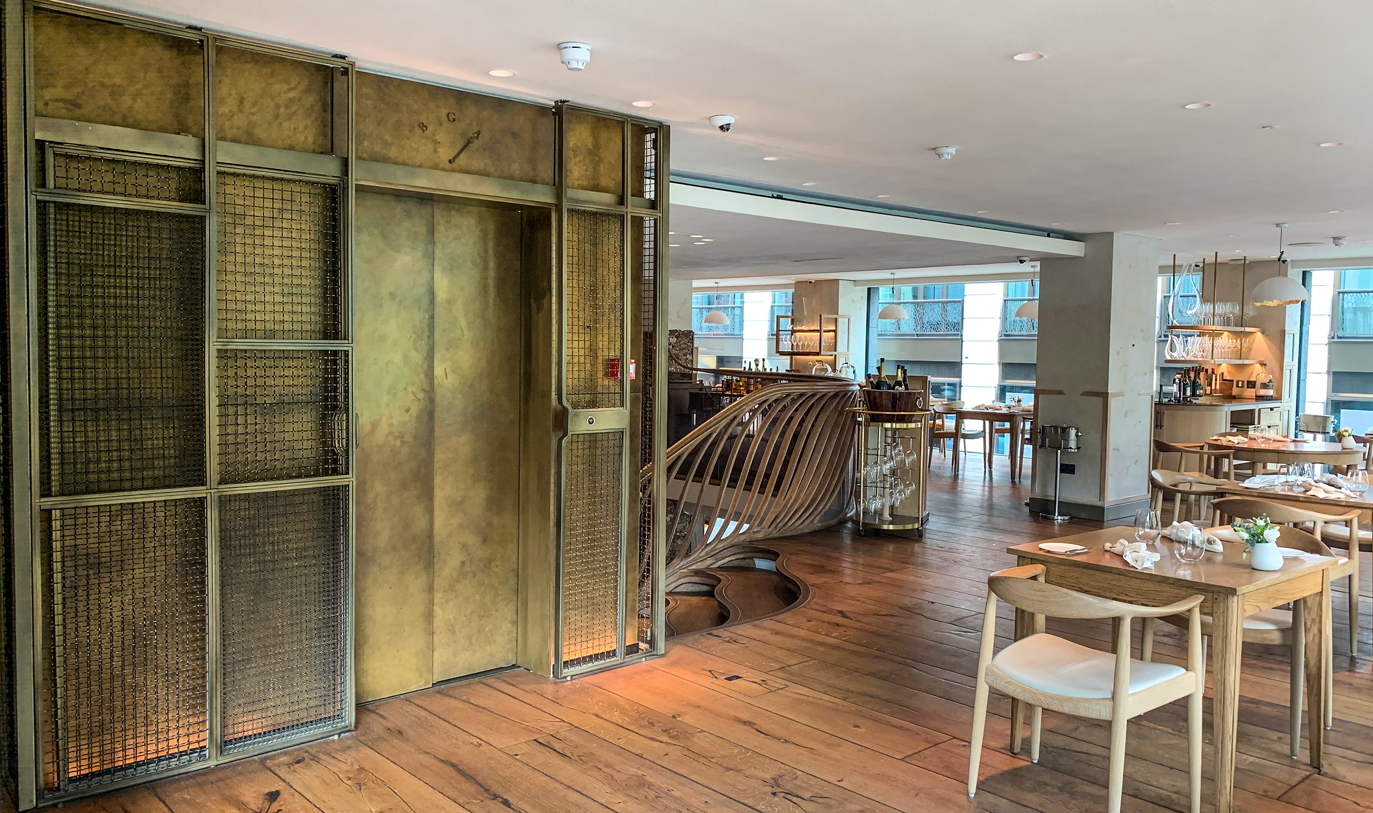 Hide at 85 Picadilly features Banker Wire's M22-28 and I-188 in an antique brass secondary finish as cladding for the elevator.