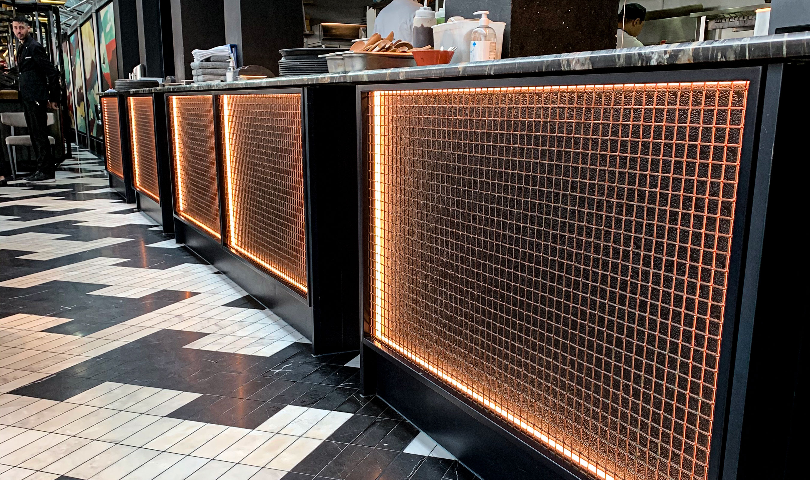 SUSHISAMBA utilizes Banker Wire's L-81 in copper to clad counters near the kitchen.