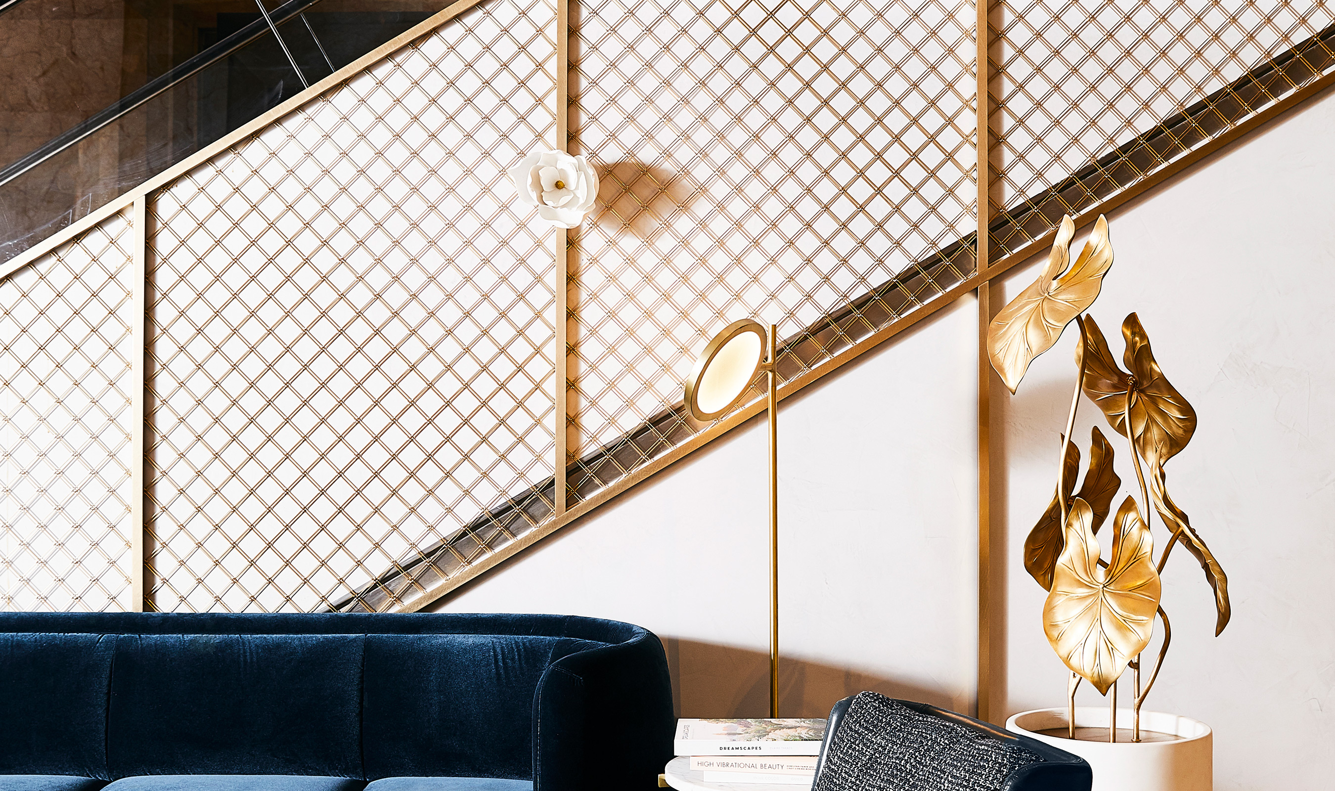 Banker Wire's M22-34 is woven in brass and used as cladding on the escalators at the 900 North Michigan Shops in Chicago.
