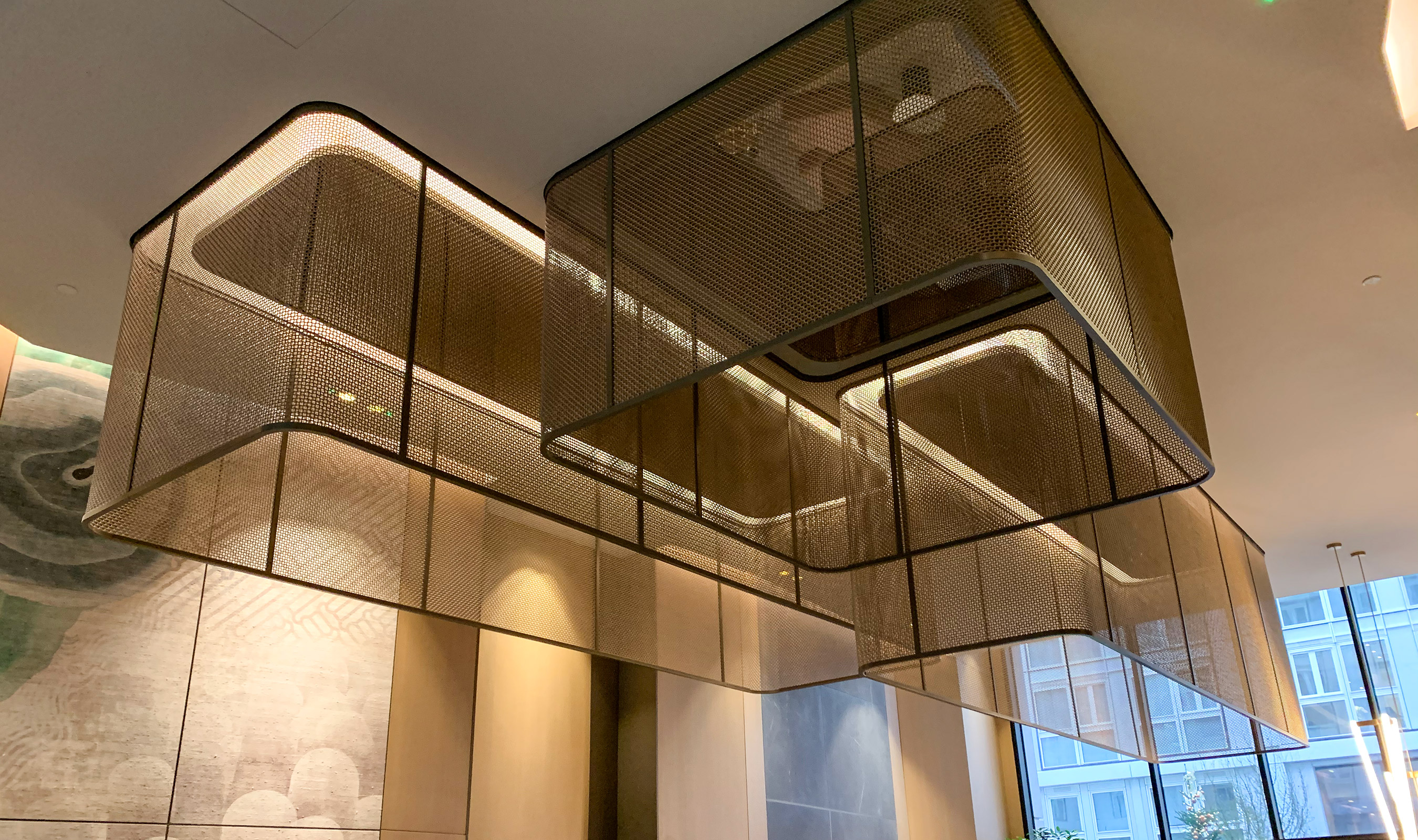 Banker Wire's M22-83 in mixed Stainless Steel and Bronze is used as chandeliers in the lobby of Lincoln Square.