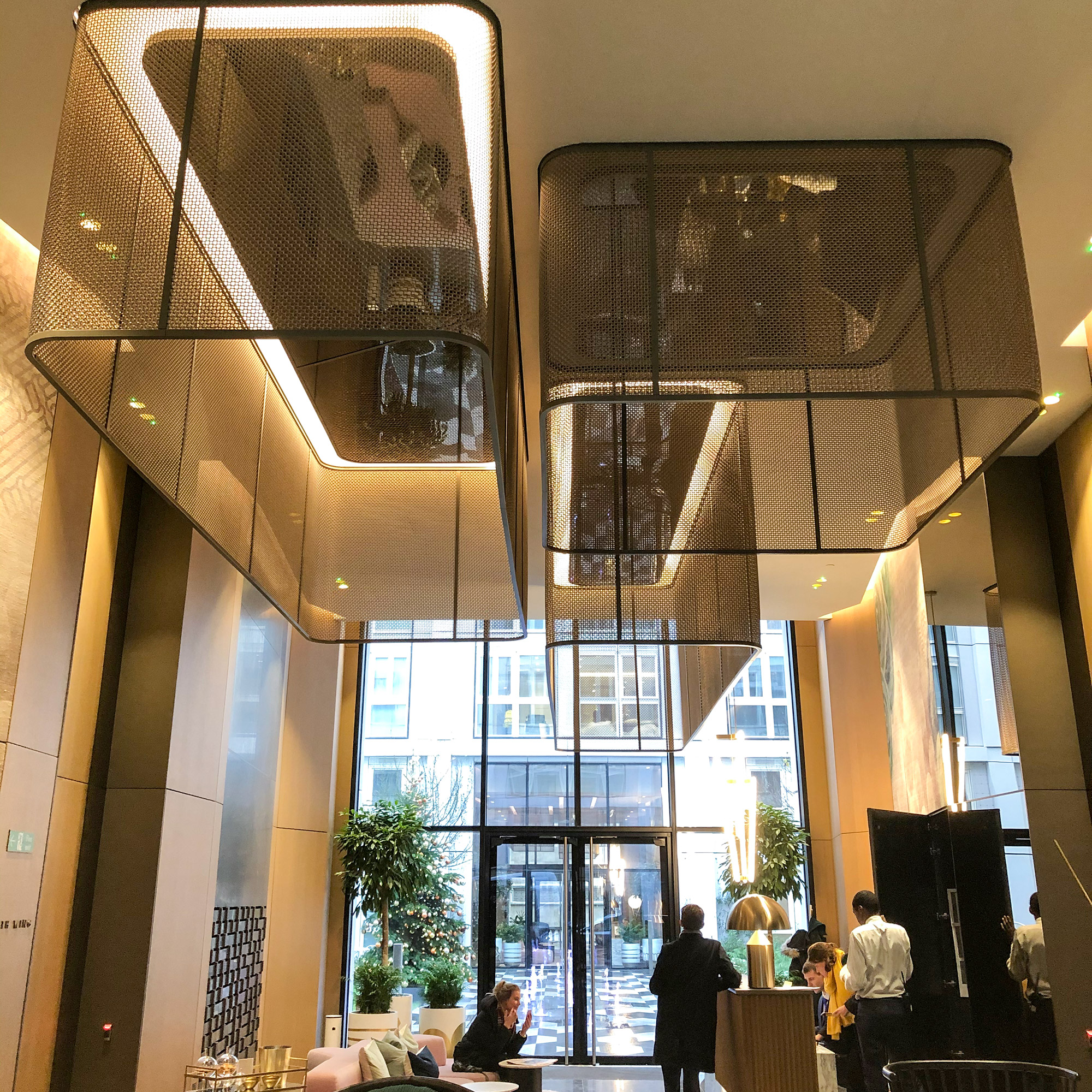 Throughout Lincoln Square, Banker Wire's M22-83 is used in a variety of places like the lobby as chandeliers, the hallways as wall cladding, and in various suites as partitions.