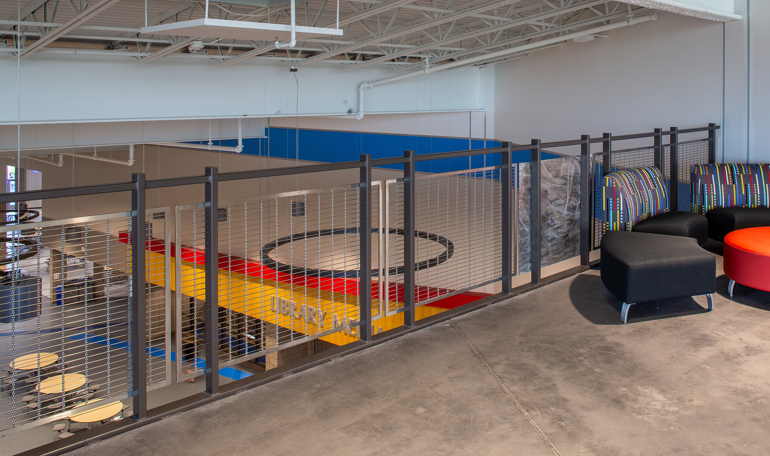 The large percent open area and sleek design of Banker Wire's M13Z-7 woven wire mesh pattern allows the railing infill panels to blend in with surroundings while adding a decorative texture to the space.
