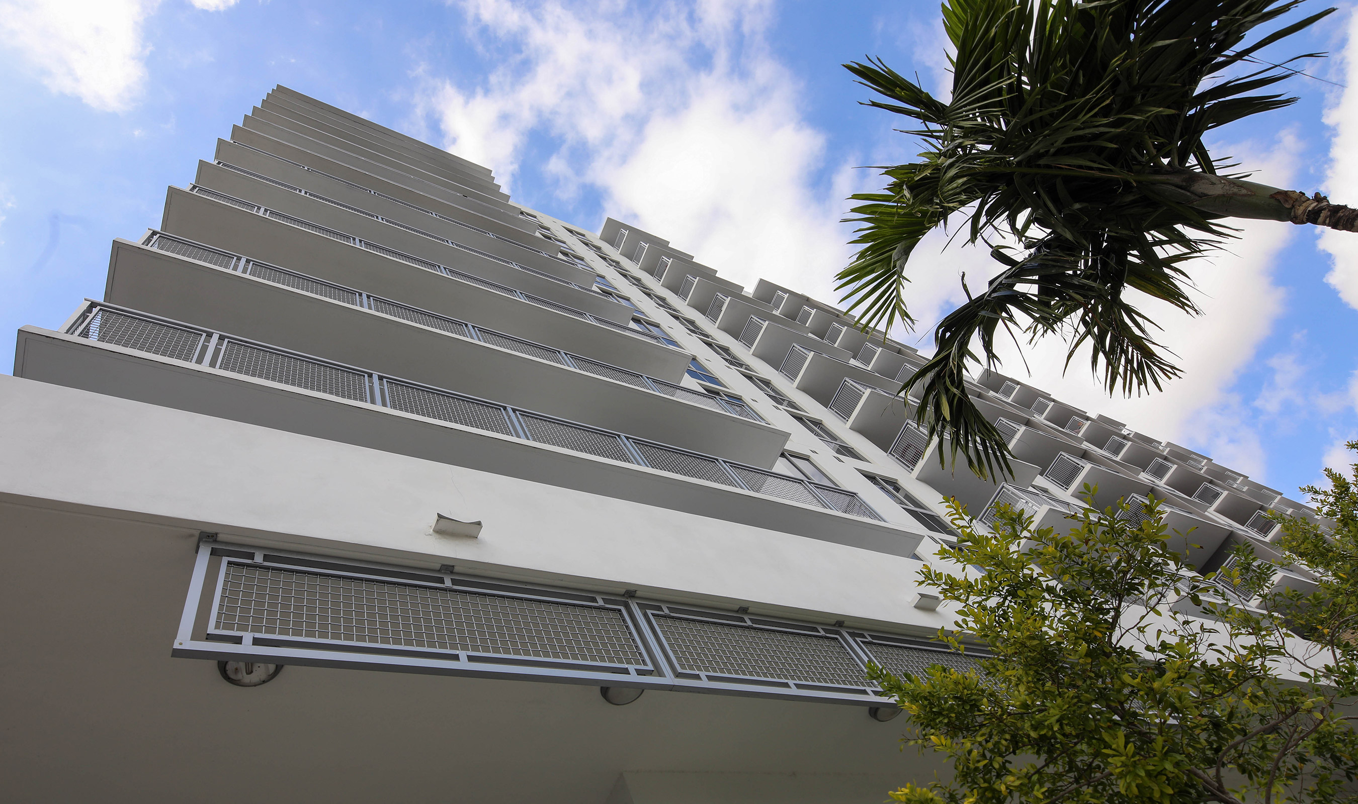All exterior balcony railing at the Grove Station Tower in Miami , Florida uses Banker Wire's L-64 woven wire mesh in powder coated aluminum.