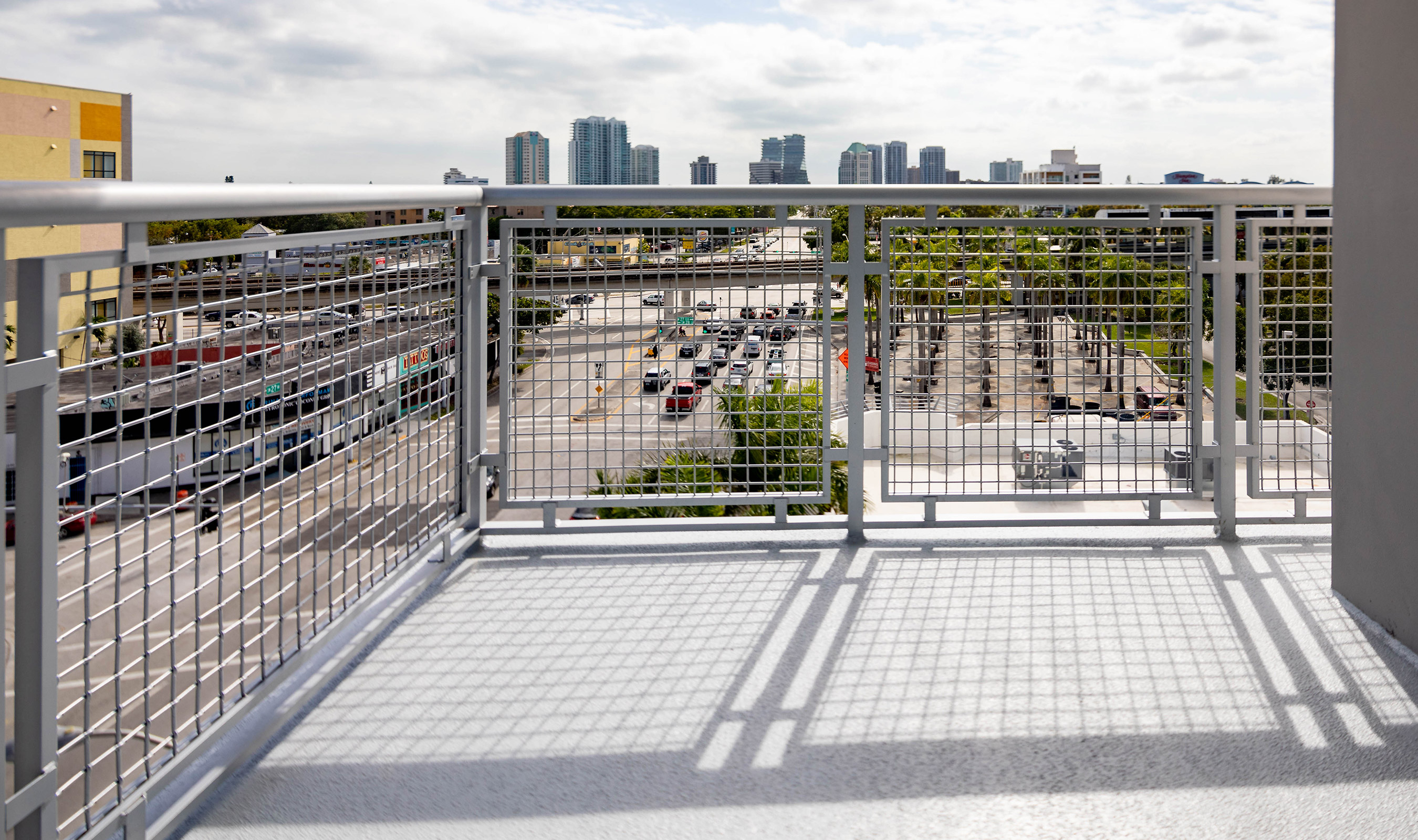 The skyline of Miami can easily be seen with the large percent open area of Banker Wire's L-64 woven wire mesh.