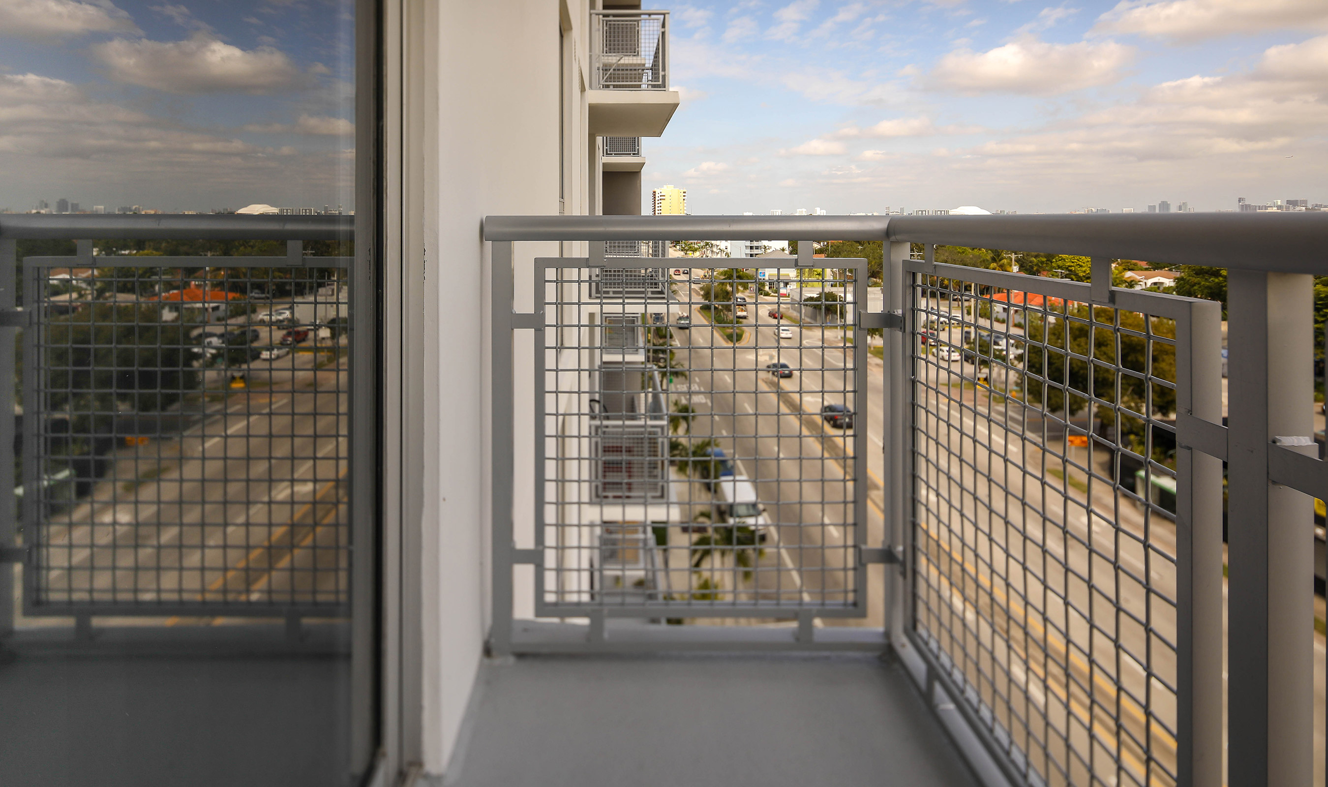 Banker Wire's L-64 woven wire mesh is used as balcony railing for Grave Station Tower luxury apartments and townhomes in Miami, Florida.