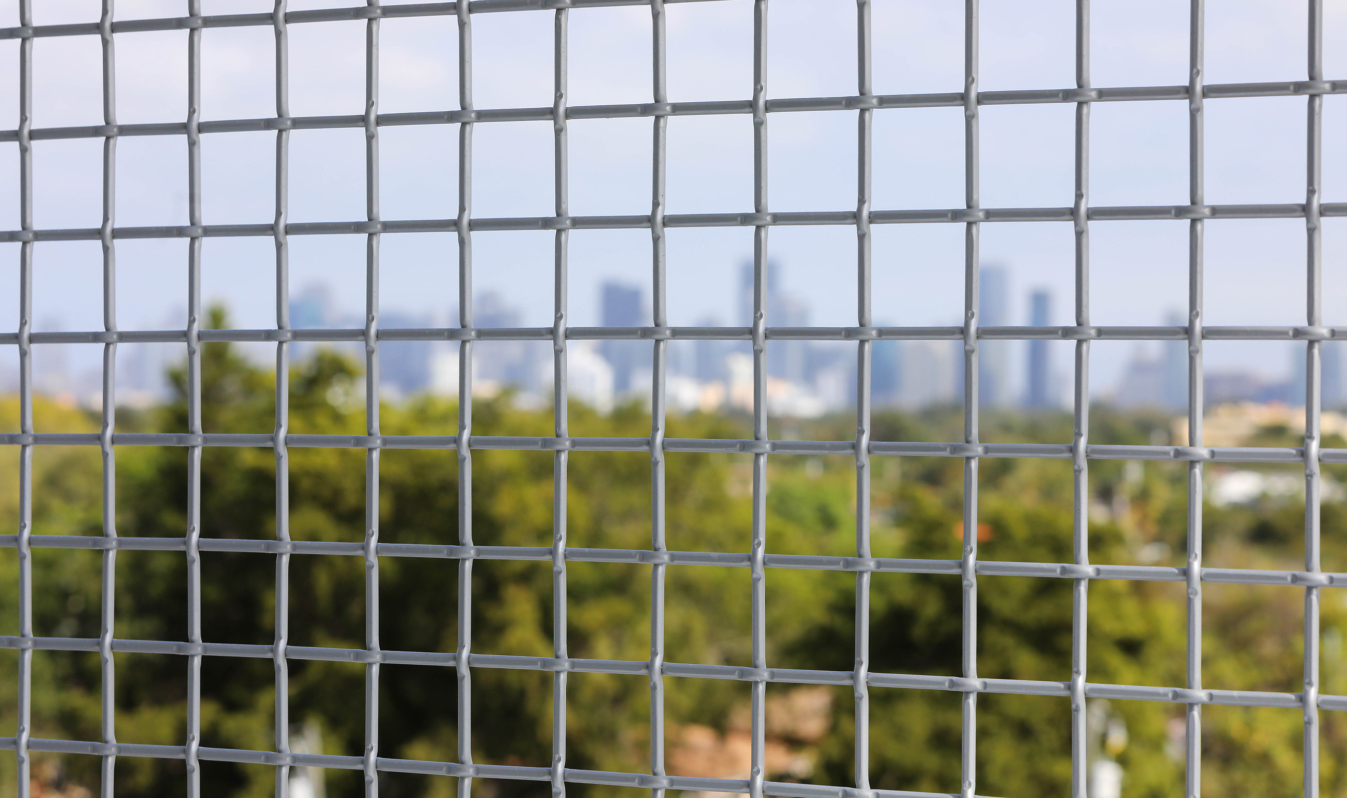 The large percent open area of Banker Wire's L-64 woven wire mesh pattern allows for uninterrupted views of the Miami skyline.