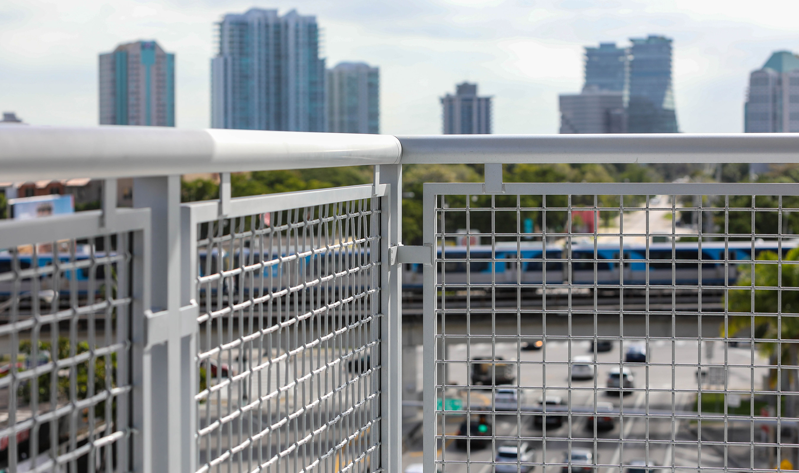 Banker Wire's L-64 woven wire mesh in powder coated aluminum is a perfect combination for dealing with the Florida coastline's corrosive nature.