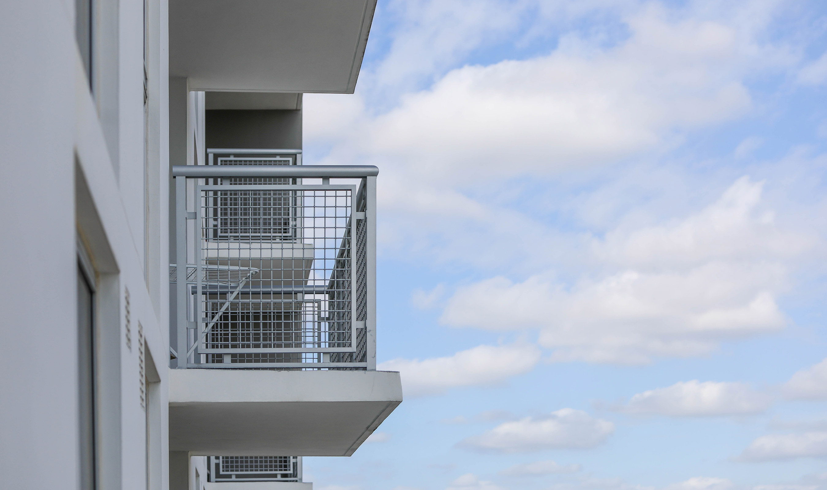 Grove Station Tower utilizes Banker Wire's L-64 as exterior balcony railing.